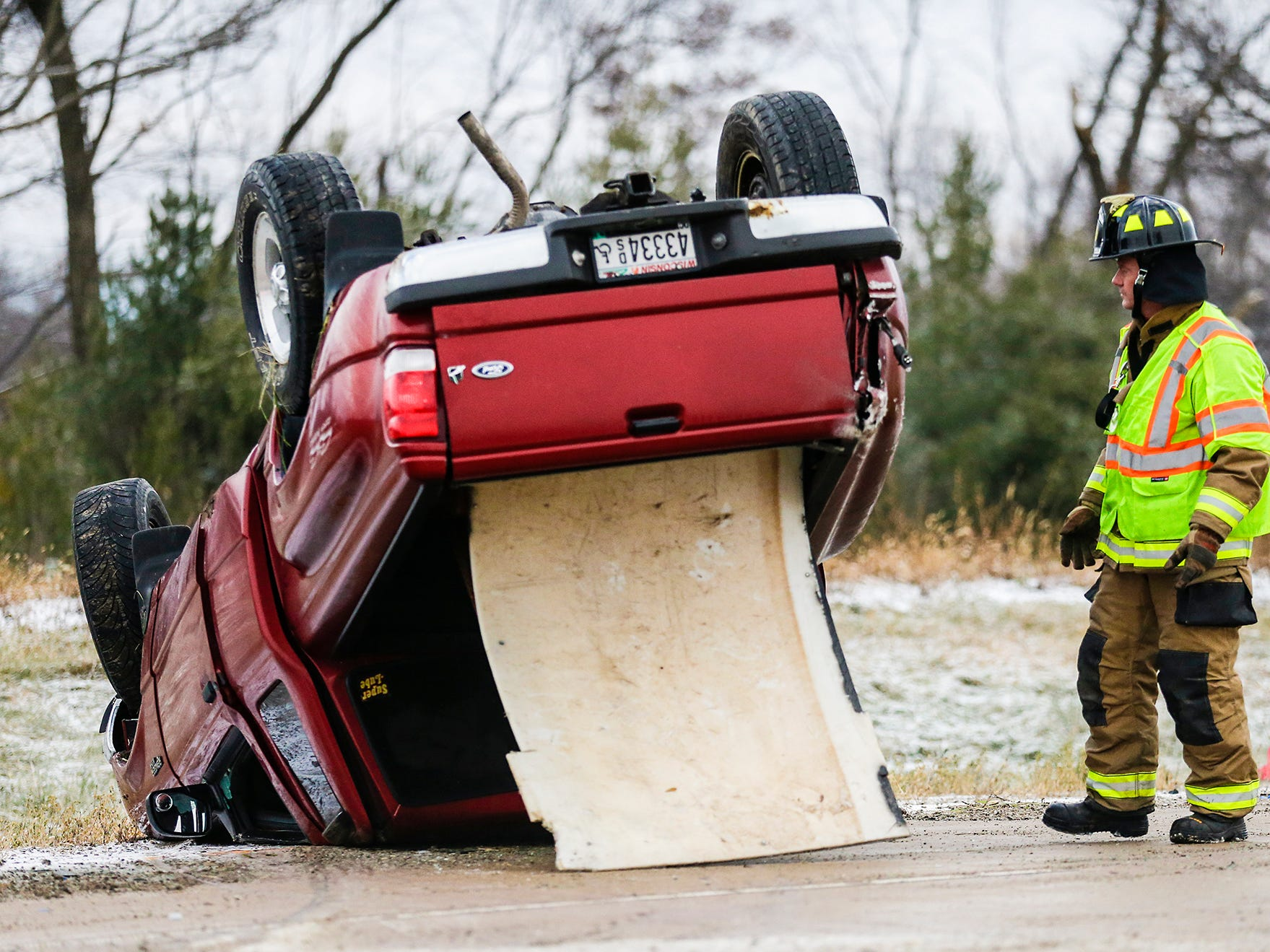 A Waupun firefighter looks over a pick-up truck that crashed Saturday, November 17, 2018 on State Highway 151 near County AS. One person was injured in the crash. Doug Raflik/USA TODAY NETWORK-Wisconsin