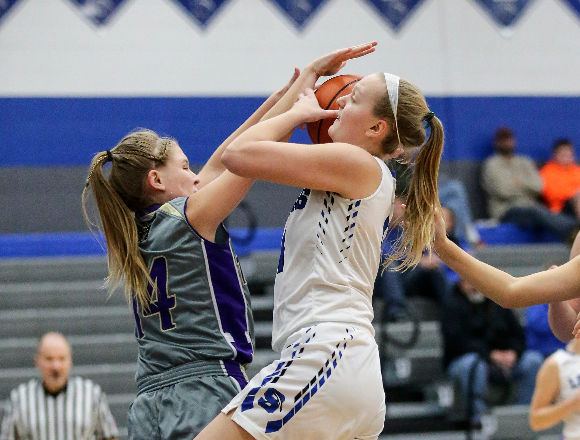 St. Mary's Springs girls basketball's Brianna Freund gets fouled by Two Rivers High School's Andrea Henrickson during their game Friday, November 16, 2018 in Fond du Lac. Doug Raflik/USA TODAY NETWORK-Wisconsin