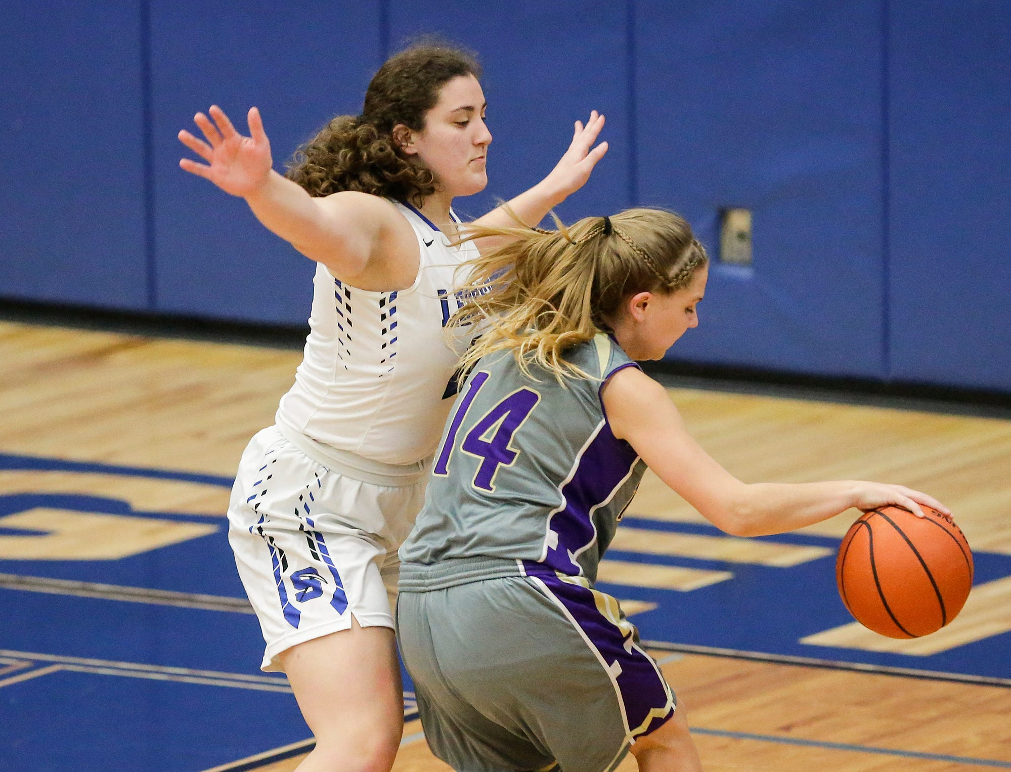 St. Mary's Springs girls basketball's Cecelia Rodriguez defends against Two Rivers High School's Andrea Henrickson during their game Friday, November 16, 2018 in Fond du Lac. Doug Raflik/USA TODAY NETWORK-Wisconsin