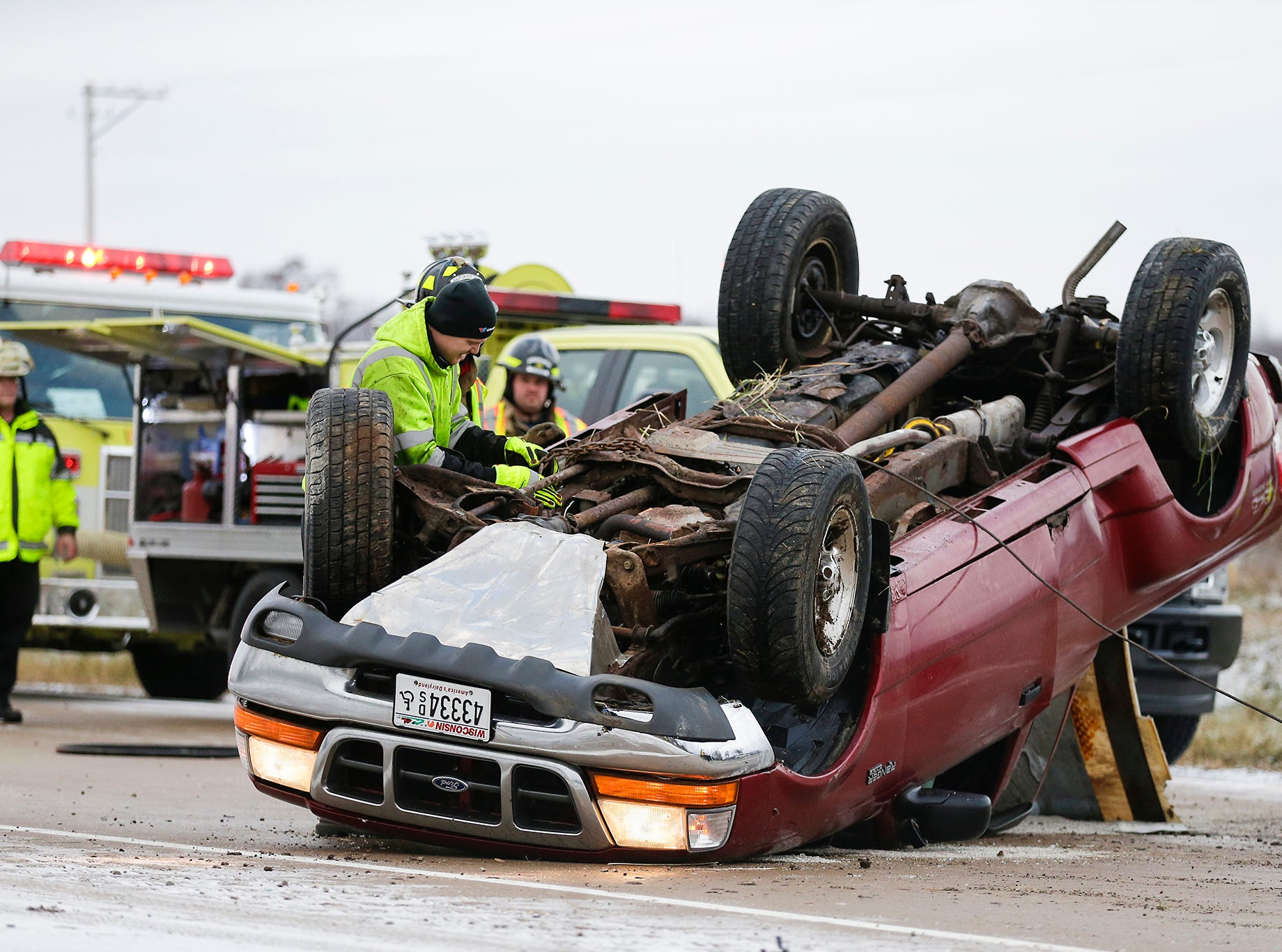Emergency responders work the scene of a single vehicle crash Saturday, November 17, 2018 where a pick-up truck traveling south on State Highway 151 lost control and crossed the median and rolled onto it's roof in the north bound lanes of the highway. Doug Raflik/USA TODAY NETWORK-Wisconsin