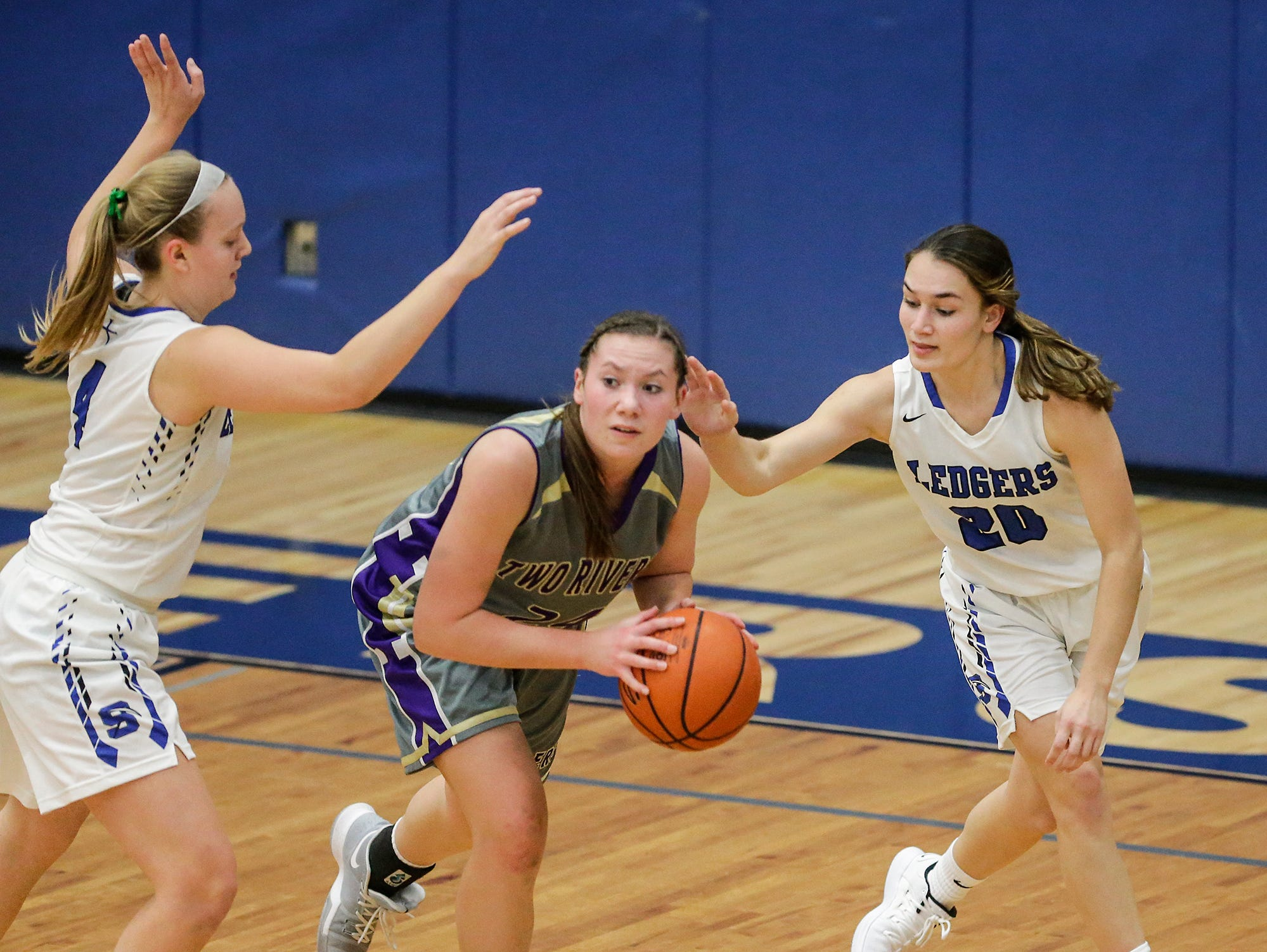 St. Mary's Springs girls basketball's Brianna Freund (4) and Jenna Gilgenbach (20) defend against Two Rivers High School's Kiley Graff during their game Friday, November 16, 2018 in Fond du Lac. Doug Raflik/USA TODAY NETWORK-Wisconsin