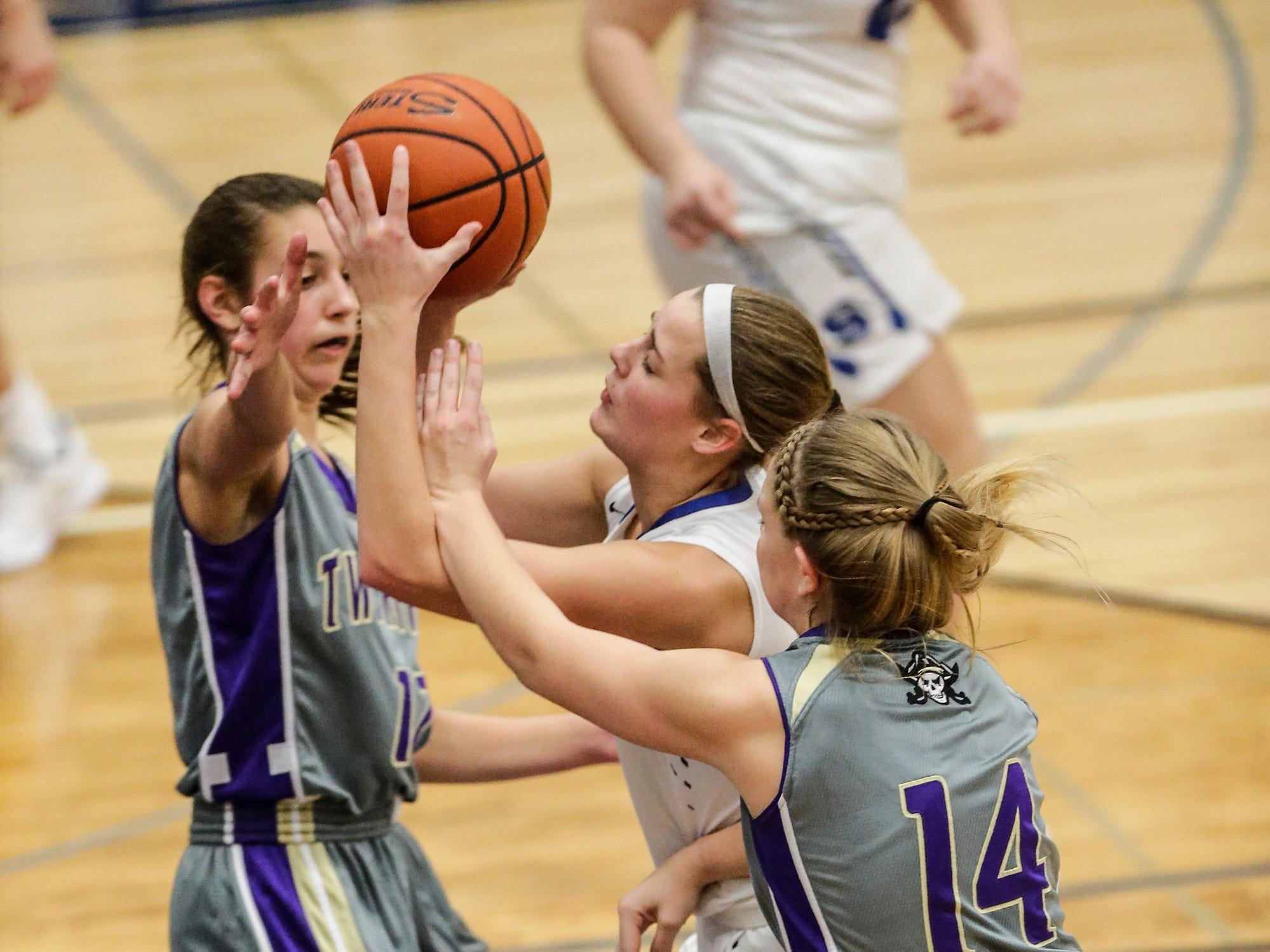 St. Mary's Springs girls basketball's Jennifer Chatterton splits Two Rivers High School's Ariana Zimney and Andrea Henrickson as she drives towards the basket during their game Friday, November 16, 2018 in Fond du Lac. Doug Raflik/USA TODAY NETWORK-Wisconsin