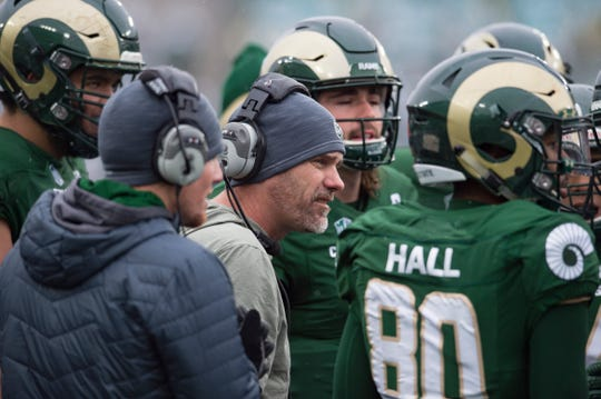 Coach Mike Bobo, shown huddling up with his team during a Nov. 17, 2018, game against Utah State, will put his CSU football team through its annual spring game at 5:15 p.m. Thursday. Wednesday's blizzard forced CSU to change plans for a public scrimmage at Canvas Stadium to a closed session at the school's Indoor Practice Facility.