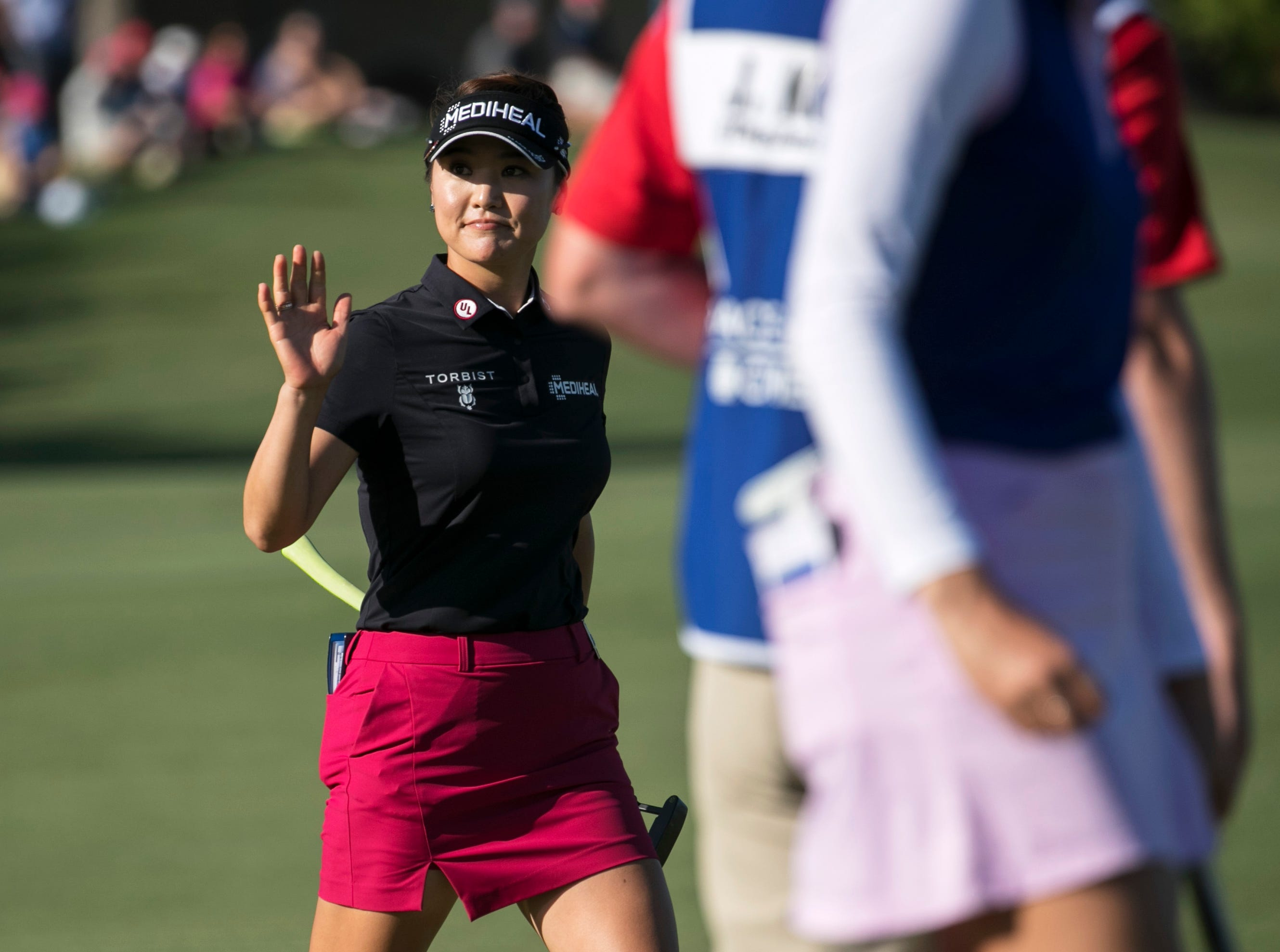 So Yeon Ryu waves to the crowd on the 18th green during the third round of the CME Group Tour Championship on Saturday, November 17, 2018, at Tiburon Golf Club in Naples.