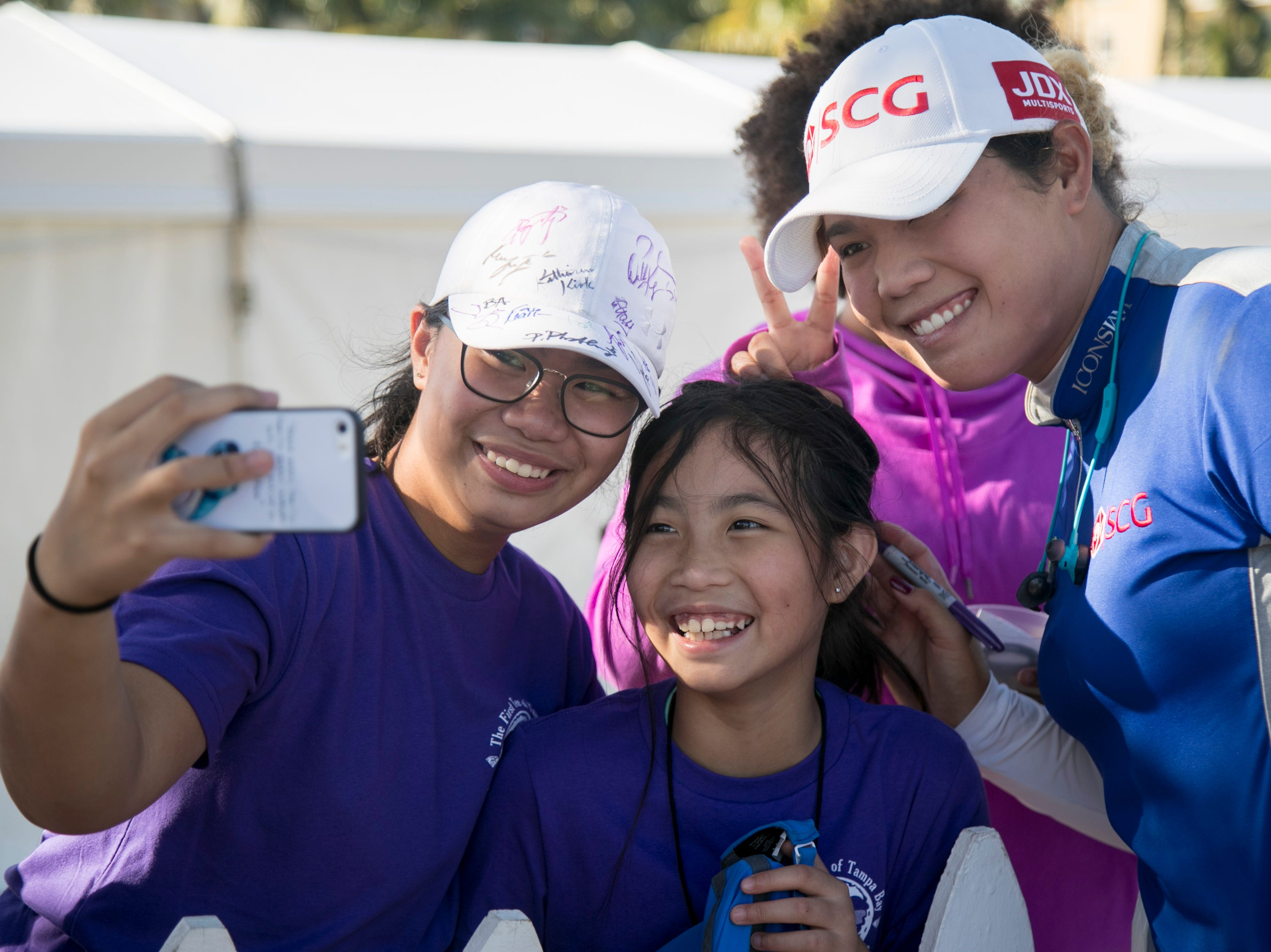 Hazel Paredes, left, and her sister Dylan get a selfie with Ariya Jutanugarn after the third round of the CME Group Tour Championship on Saturday, November 17, 2018, at Tiburon Golf Club in Naples.