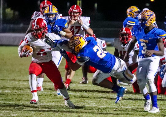 North's Shomari Mason is snagged by Charlotte's Zenen Chamizo. North Fort Myers played at Charlotte in their regional semifinal. North won 36-20 and will play Naples in next week's game.