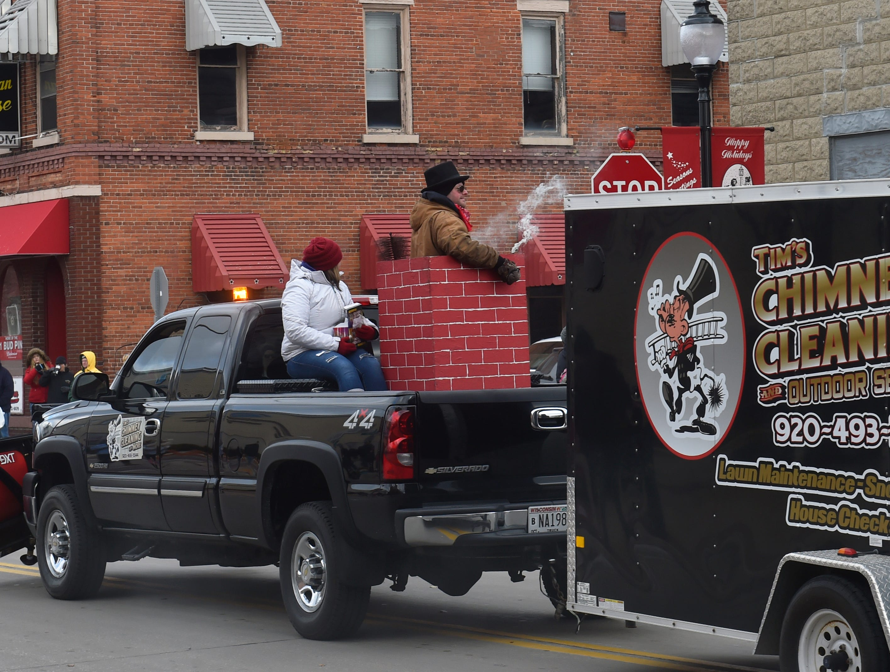 """A """"smoking'' chimney from Tim's Chimney Cleaning and Outdoor Services float at the Christmas By The Bay parade on Saturday, Nov. 17, 2018, in Sturgeon Bay. Tina M. Gohr/USA TODAY NETWORK-Wisconsin"""