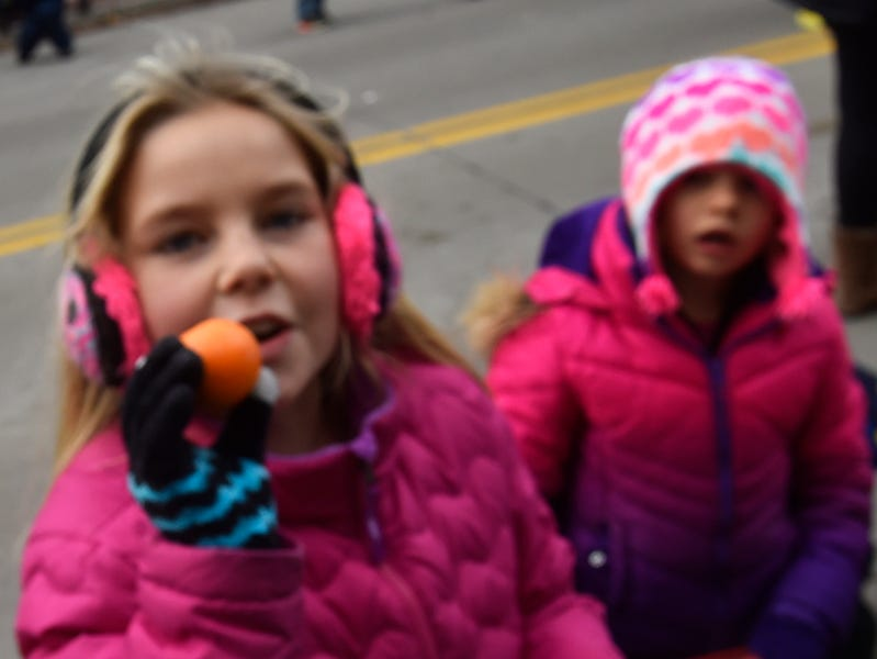 Tadych's Econo Foods hands out mandarin oranges to the parade crowd including Gretta Gunnlaugsson at the Christmas By The Bay parade on Saturday, Nov. 17, 2018, in Sturgeon Bay. Tina M. Gohr/USA TODAY NETWORK-Wisconsin