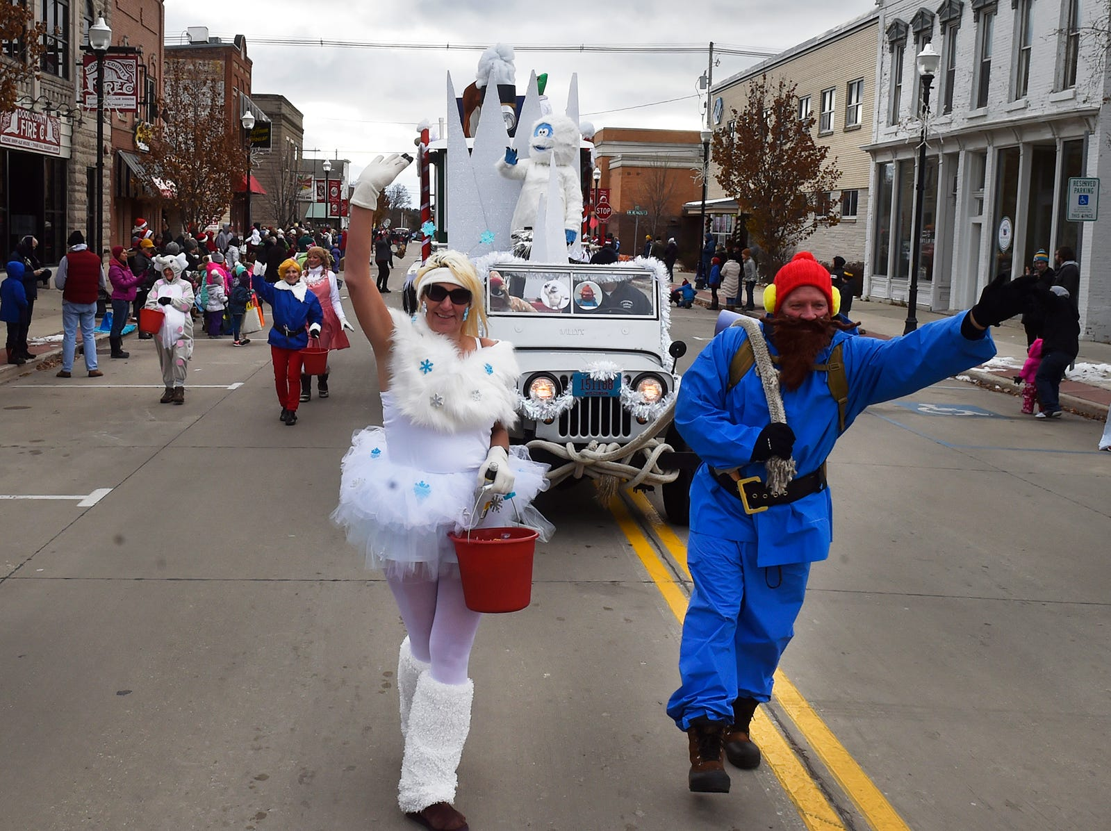 Selvick Marine & Towing float with Carla Mickey and Buddy Paul at the Christmas By The Bay parade on Saturday, Nov. 17, 2018, in Sturgeon Bay. Tina M. Gohr/USA TODAY NETWORK-Wisconsin
