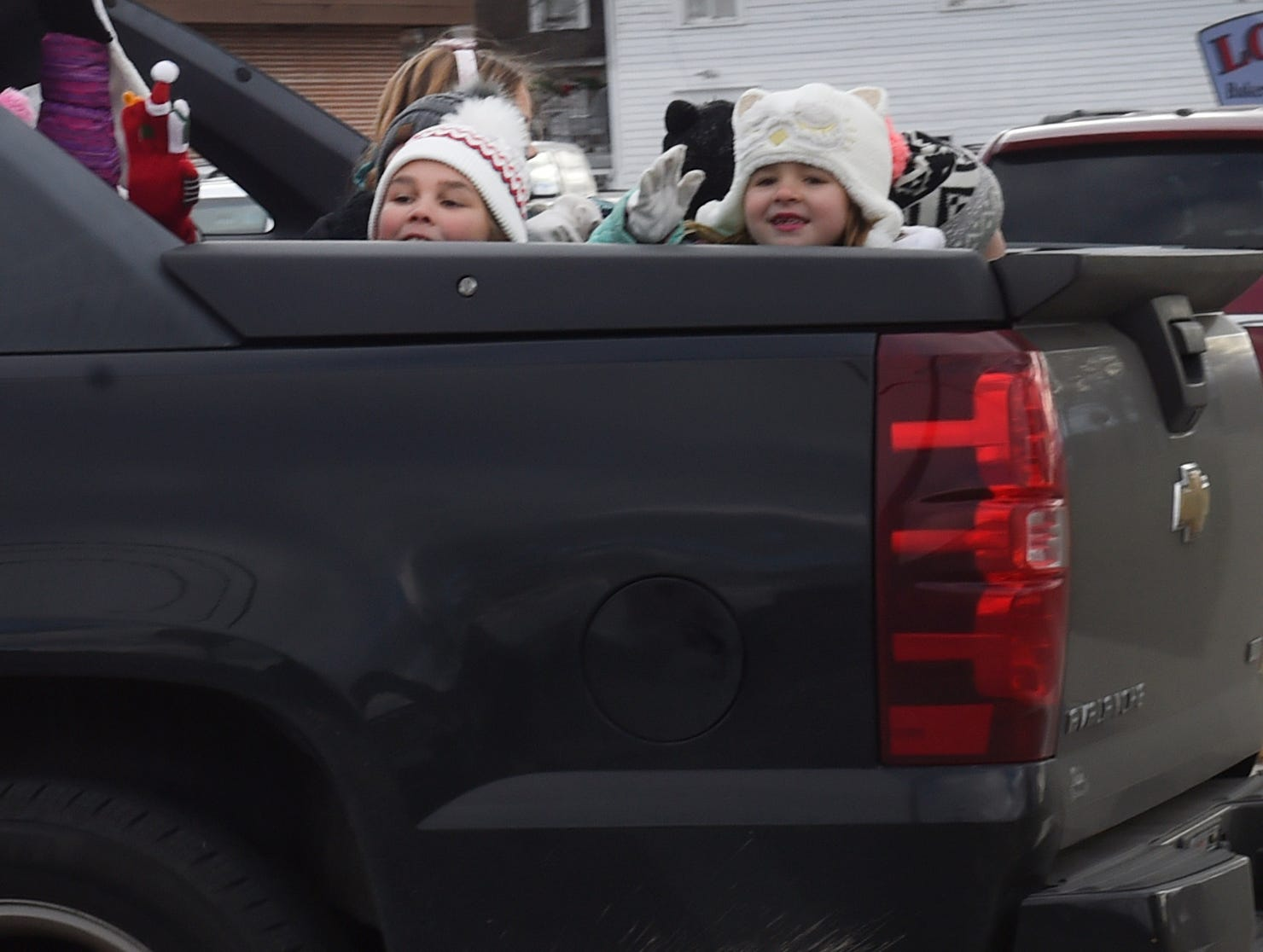 Tiny tots wave from the back end a pick-up truck at the Christmas By The Bay parade on Saturday, Nov. 17, 2018, in Sturgeon Bay. Tina M. Gohr/USA TODAY NETWORK-Wisconsin