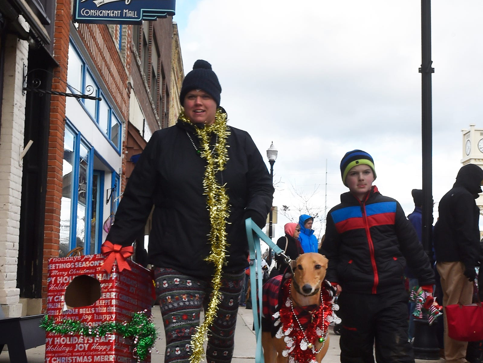"""Calyn Saindon and son Harvey along with their dog """"HotSauce'' at the Christmas By The Bay parade on Saturday, Nov. 17, 2018, in Sturgeon Bay. Tina M. Gohr/USA TODAY NETWORK-Wisconsin"""