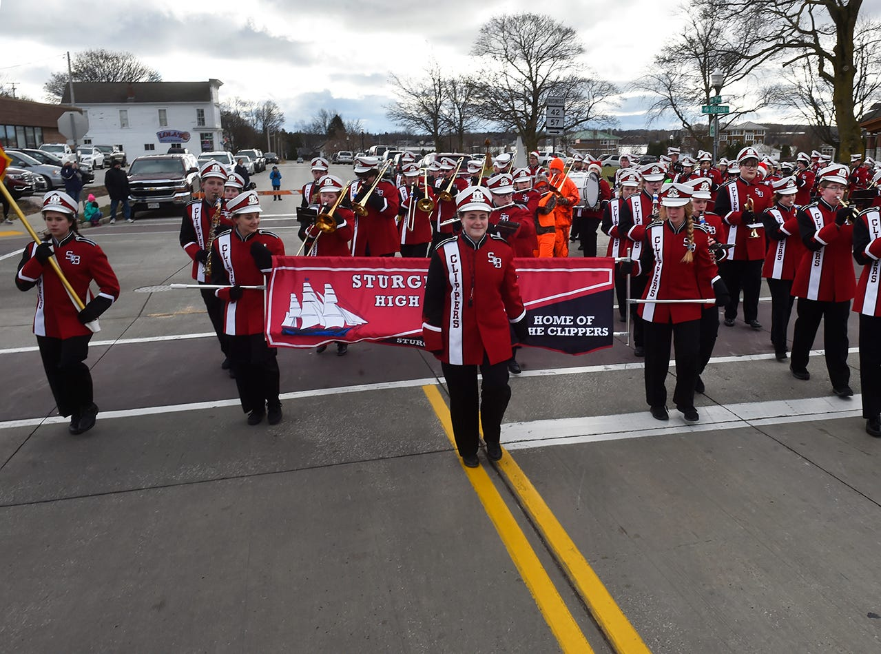 The Sturgeon Bay High School Marching Band play holiday music at the Christmas By The Bay parade on Saturday, Nov. 17, 2018, in Sturgeon Bay. Tina M. Gohr/USA TODAY NETWORK-Wisconsin