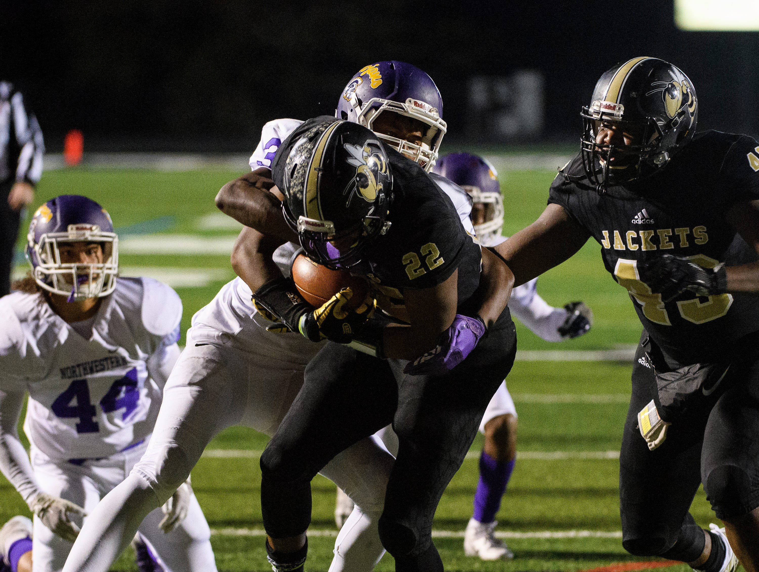 T.L. Hanna's Jaydon McKinney (22) attempts to push towards the end zone during their game against Northwestern on Friday, Nov. 16, 2018.