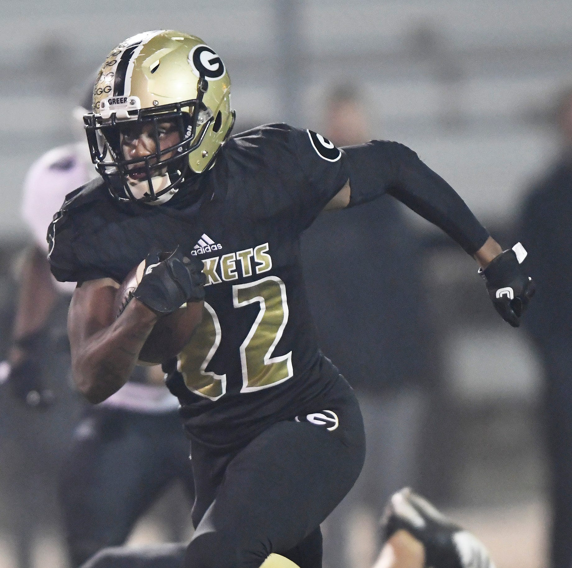 Greer's Dre Williams (22) rushes 74 yards to score on his team's first play against York in the second round of the Class AAAA playoffs  on Friday, Nov. 16, 2018, at Greer's Dooley Field.