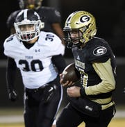 Greer quarterback Matthew Huff (17) rushes against York in the 2nd round of the class AAAA playoffs Friday, November 16, 2018 at Greer's Dooley Field.