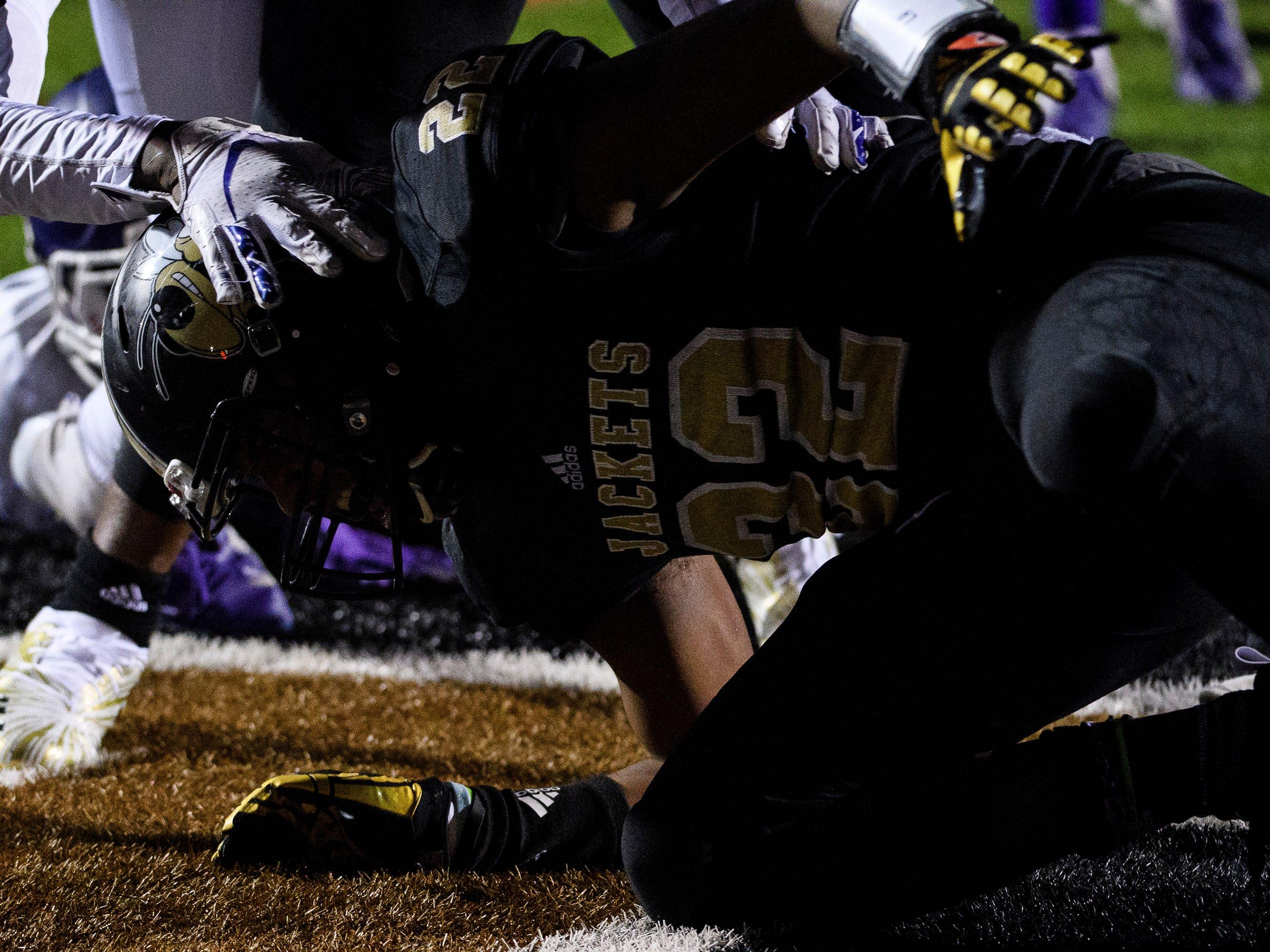 T.L. Hanna's Jaydon McKinney (22) scores a touchdown during their game against Northwestern on Friday, Nov. 16, 2018.