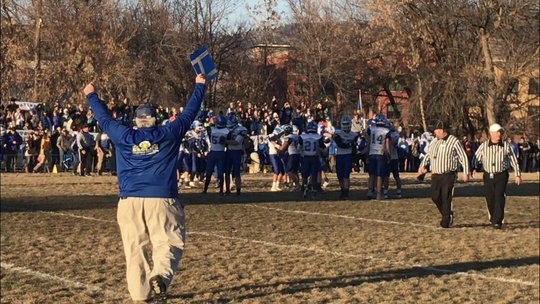 The Fairfield Eagles celebrate after defeating Missoula Loyola Saturday in Missoula to earn the State B football championship.