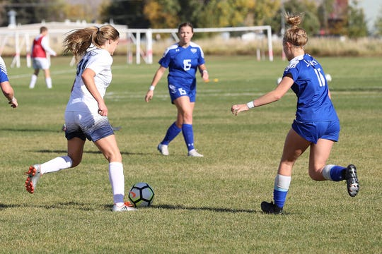 Billings Skyview's Halle Labert, right, was named to the Tribune's Super-State soccer team.