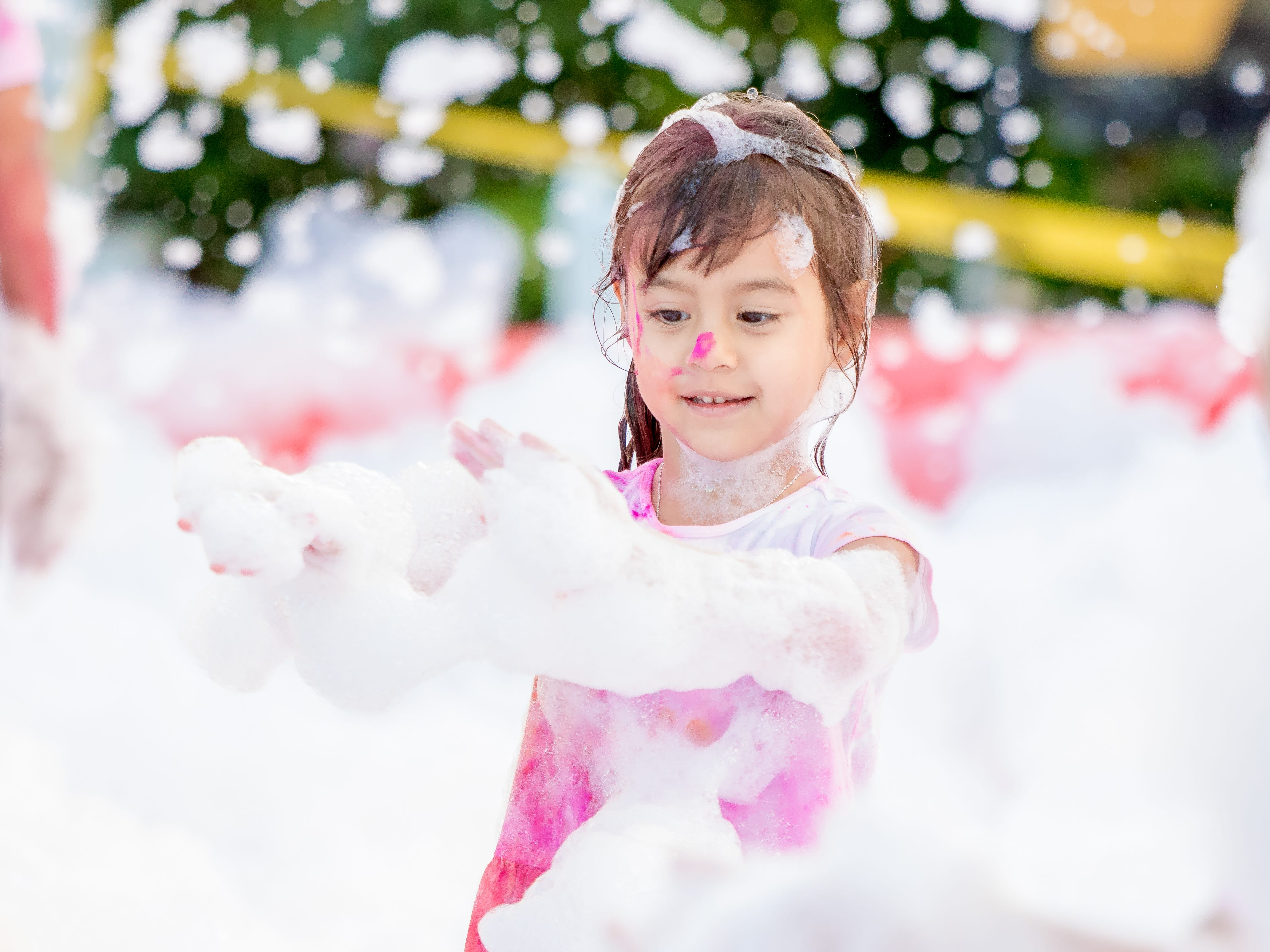 """Kids have the most fun at the bubble foam  sprayers setup during the 13th Annual Triple J Family 10K/5K Run themed the """"Bubble Color Run"""" held  at Tripple J Complex in Tamuning on Nov.17.Virgilio Valencia /For Pacific Daily News"""