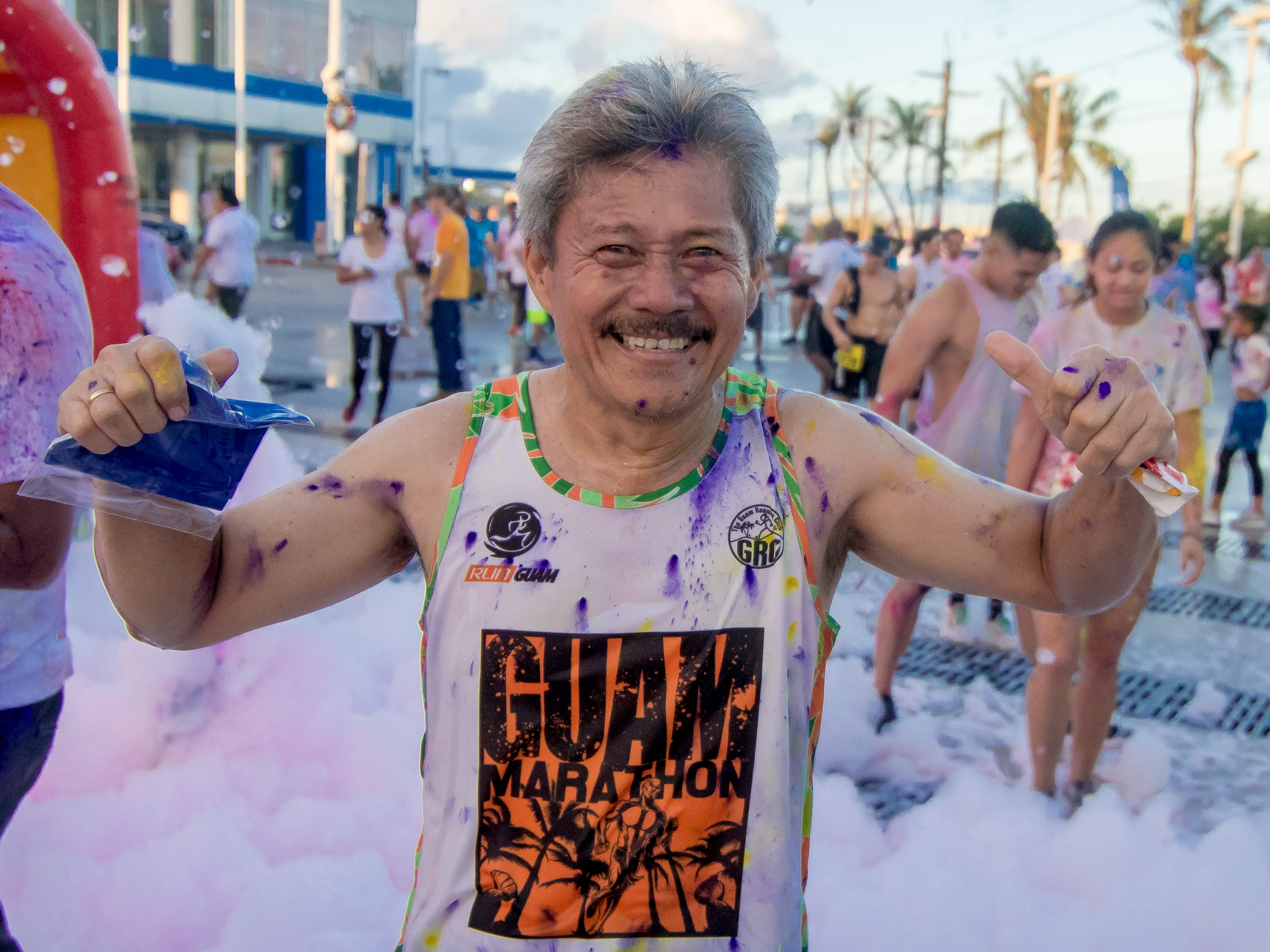 """Guam Running Club members participate the 13th Annual Triple J Family 10K/5K Run themed the """"Bubble Color Run"""" Virgilio Valencia /For Pacific Daily News"""