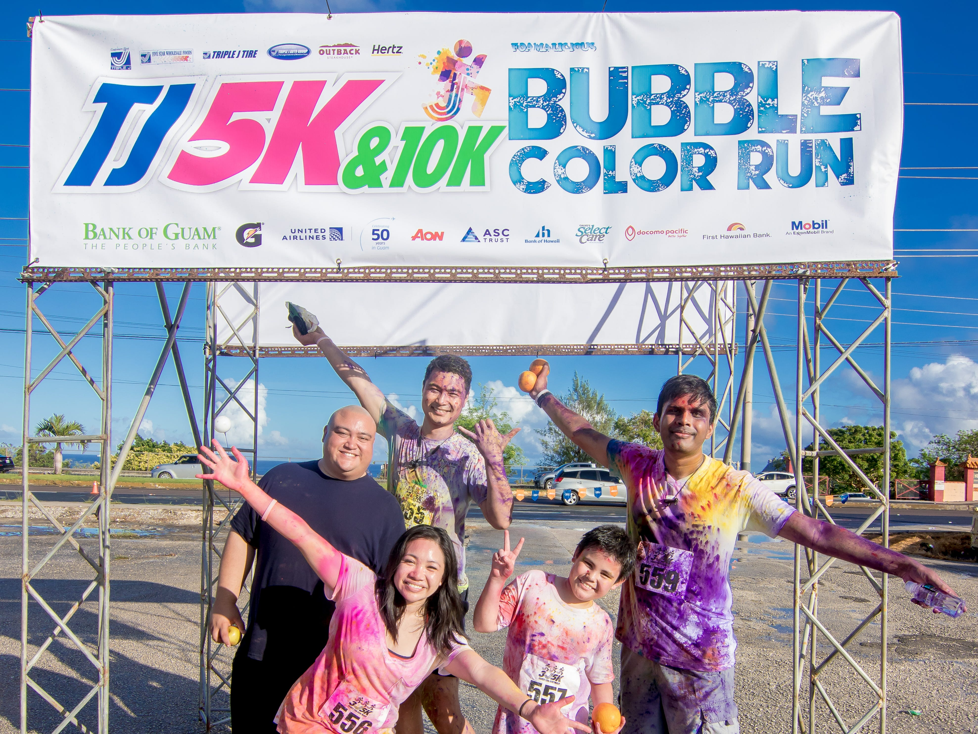 """THe 13th Annual Triple J Family 10K/5K Run themed the """"Bubble Color Run"""" was held  at Tripple J Complex in Tamuning on Nov.17.Virgilio Valencia /For Pacific Daily News"""