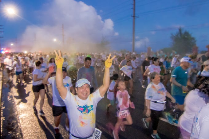 """5K participants take off during the start of the 13th Annual Triple J Family 10K/5K Run themed the """"Bubble Color Run"""" held at Tamuning on Nov. 17. Virgilio Valencia /For Pacific Daily News"""