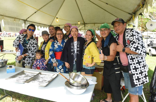 Employees from the Consulate-General of Japan in Hagatna with their families during the 39th Japan Autumn Festival at the Gov. Joseph A. Flores Memorial Park in Tumon, Nov. 17, 2018.
