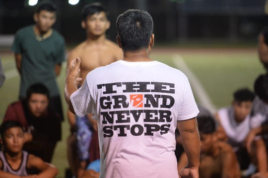 Strenth and conditioning coach Chad Ikei addresses a group of underclassmen football players during the College Football Showcase and Combine Nov. 15 at Guam High.