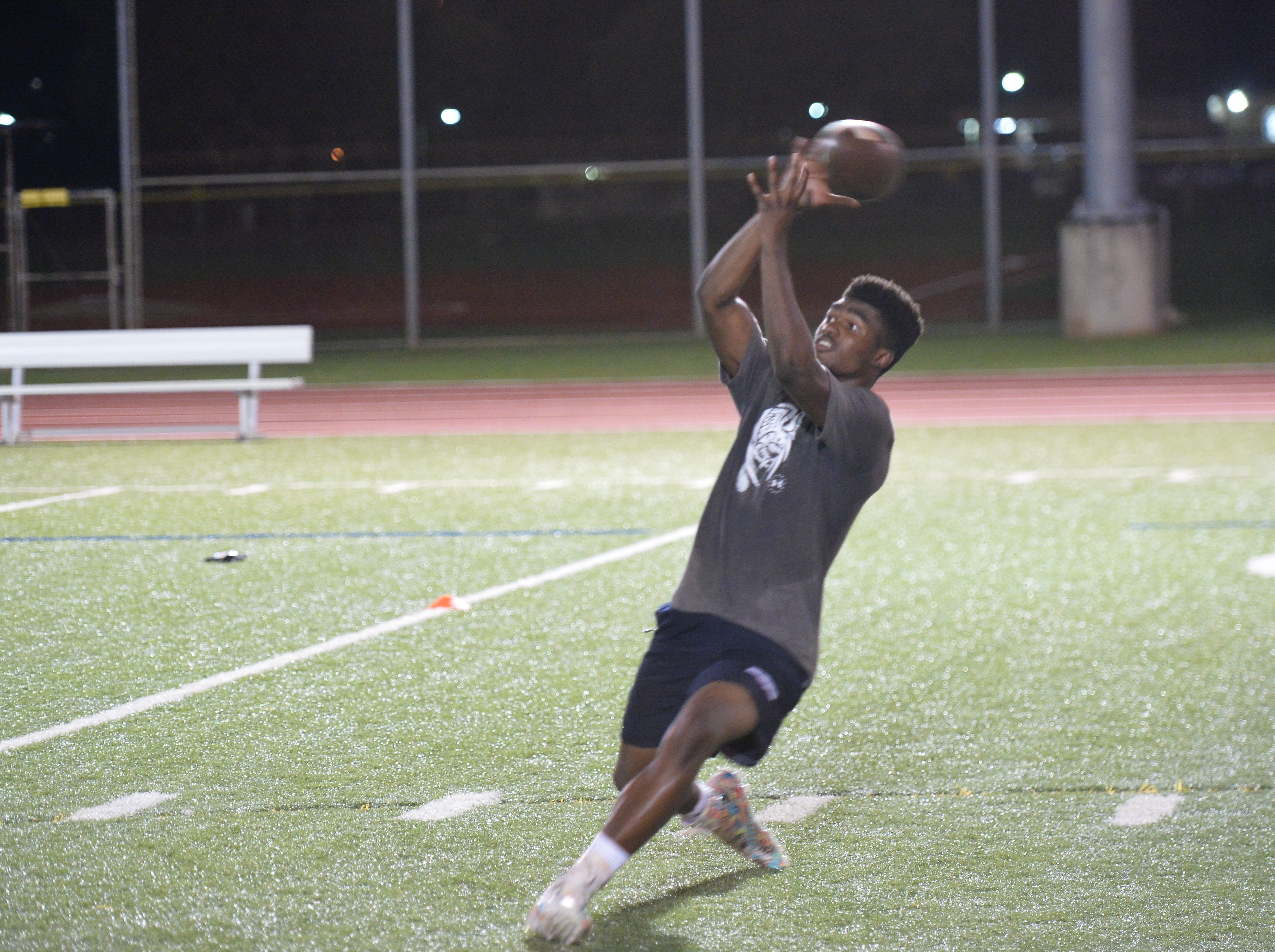 Sincere Powell maintains concentration on a bobbled ball during receiving workouts on Nov. 14 at the 2nd Annual Guam Football College Showcase and Combine.