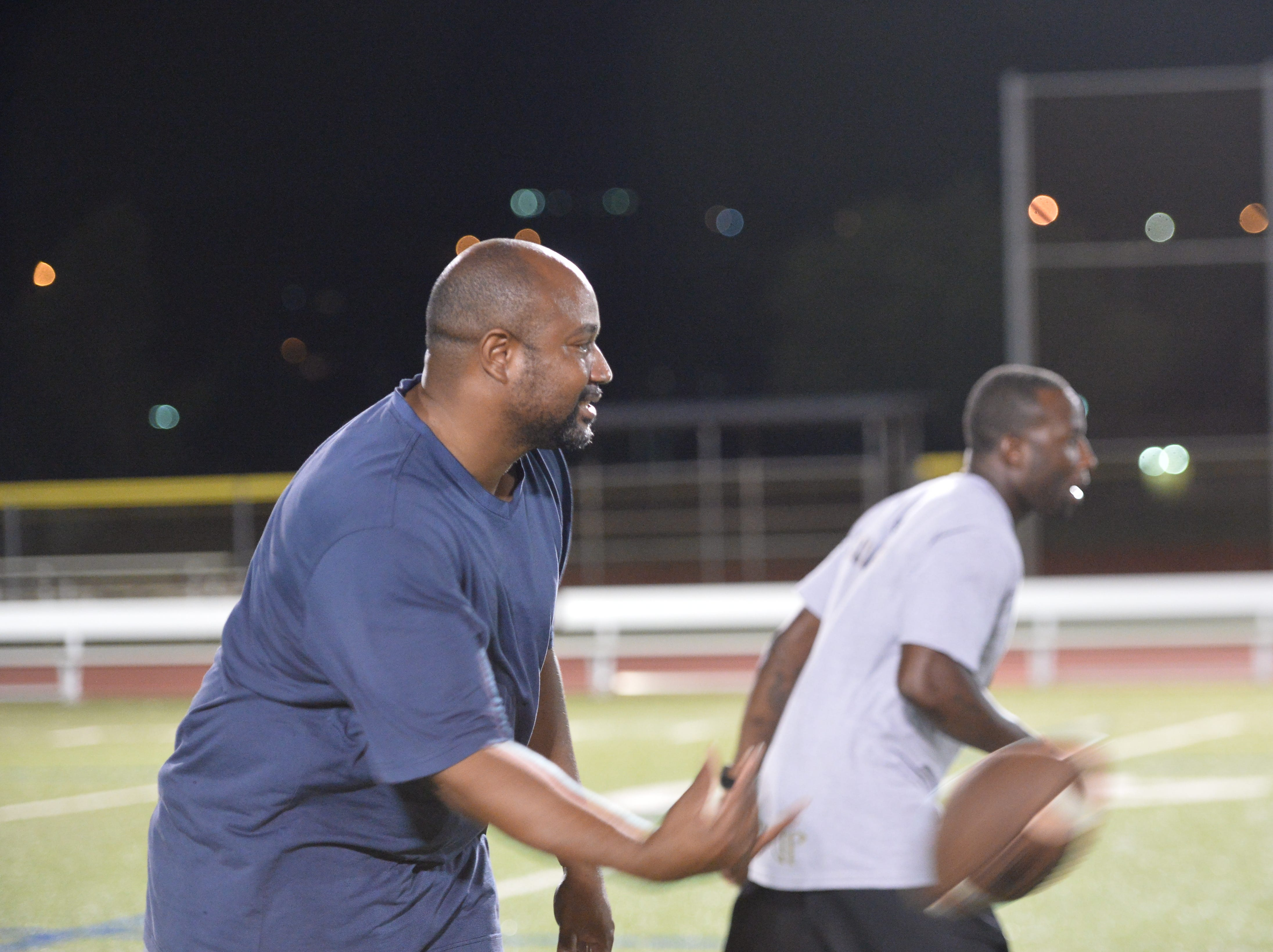 Volunteer coaches work with the quarterbacks on Nov. 14  at the 2nd Annual Guam Football College Showcase and Combine at Guam High.