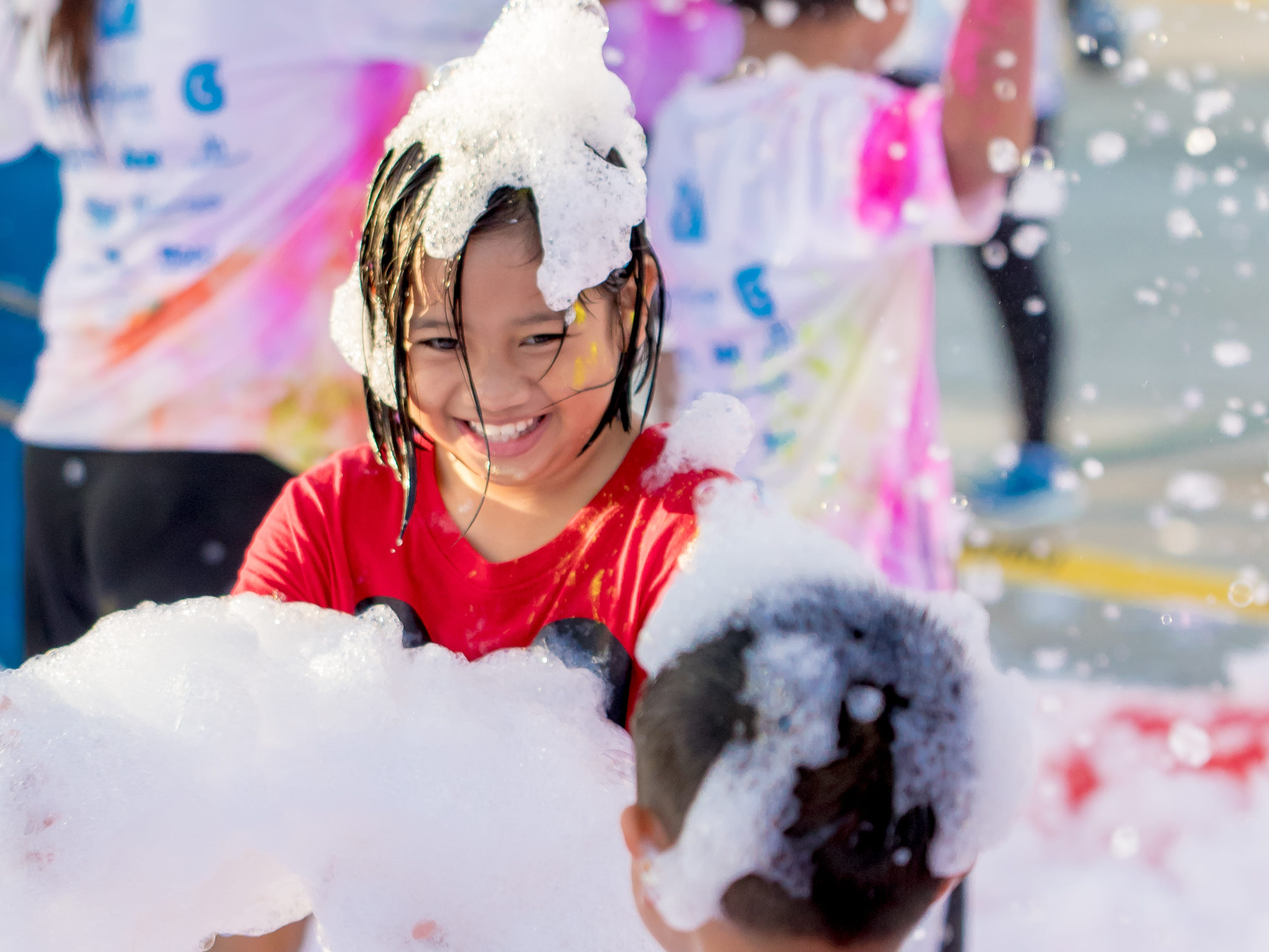 Kids have the most fun at the bubble foam Virgilio Valencia /For Pacific Daily News