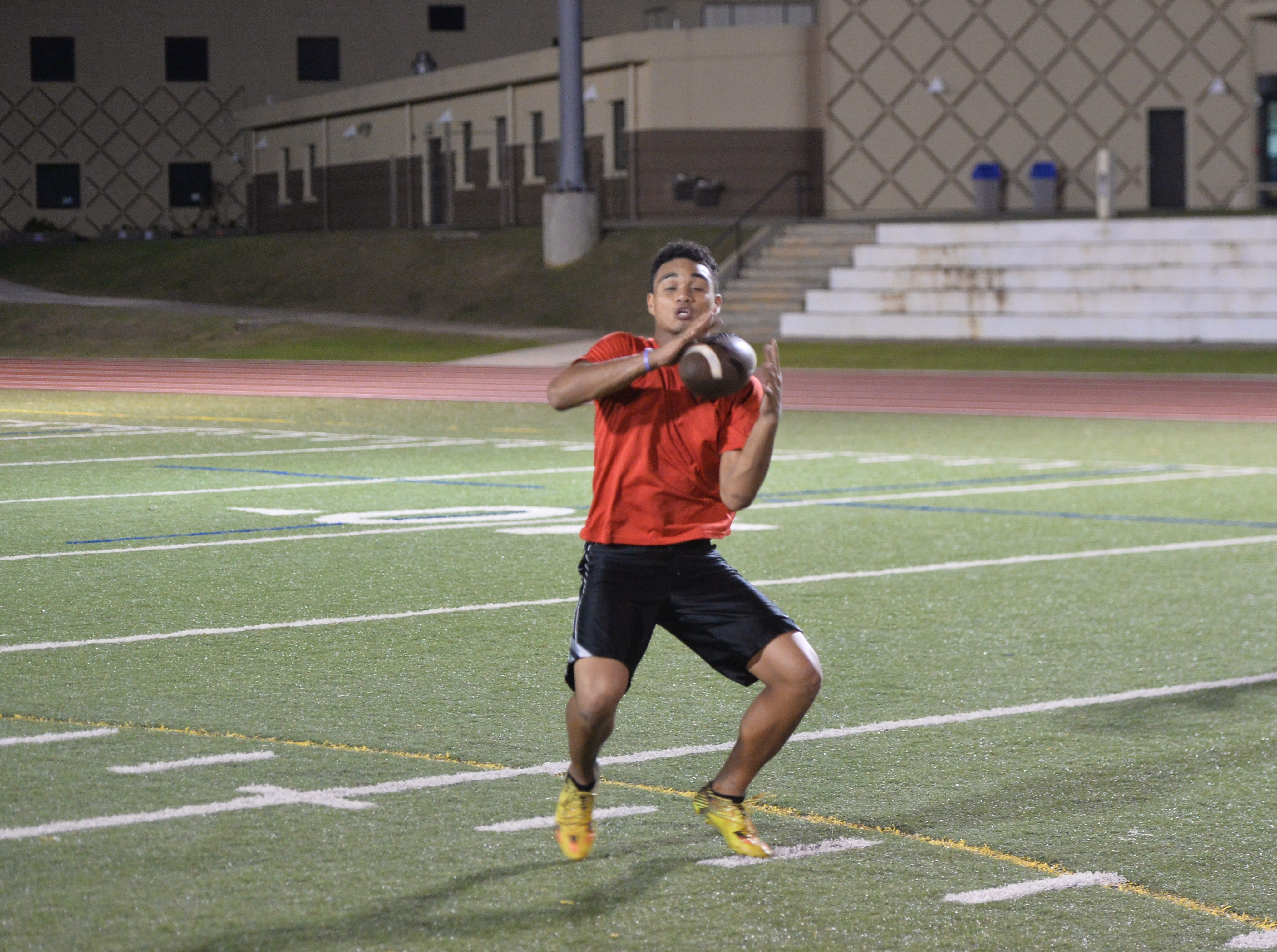 Lawrence Tisalona bobbles the ball but recovers in after catching a short pass Nov. 14 at the 2nd Annual Guam Football College Showcase and Combine.