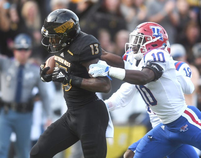 Southern Miss wide receiver Neil McLaurun fights off a defender to score a touchdown in a game against Louisiana Tech at M.M. Roberts Stadium on Saturday, November 17, 2018.