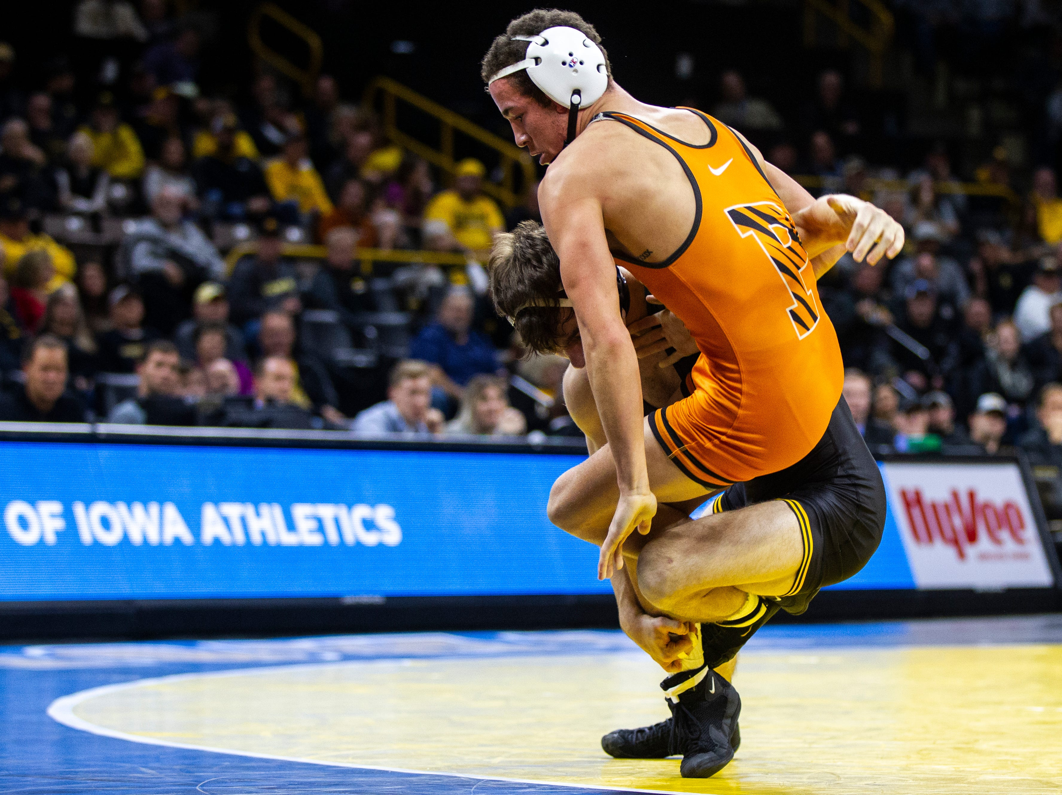 Iowa's Austin DeSanto (left) wrestles Princeton's Jonathan Gomez at 133 during an NCAA wrestle dual on Friday, Nov. 16, 2018, at Carver-Hawkeye Arena in Iowa City.
