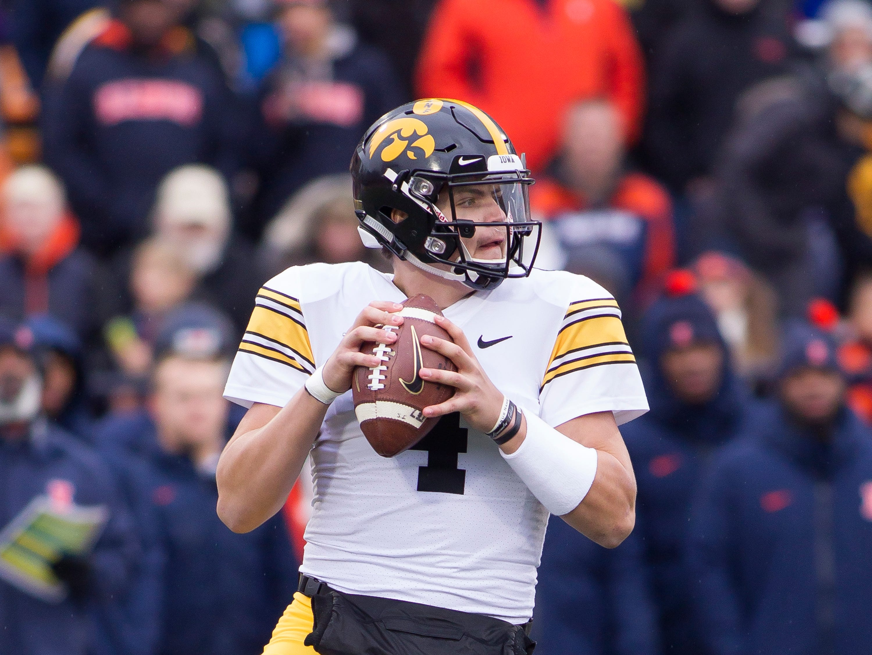 Nov 17, 2018; Champaign, IL, USA; Iowa Hawkeyes quarterback Nate Stanley (4) sets up to pass during the first quarter against the Illinois Fighting Illini at Memorial Stadium.