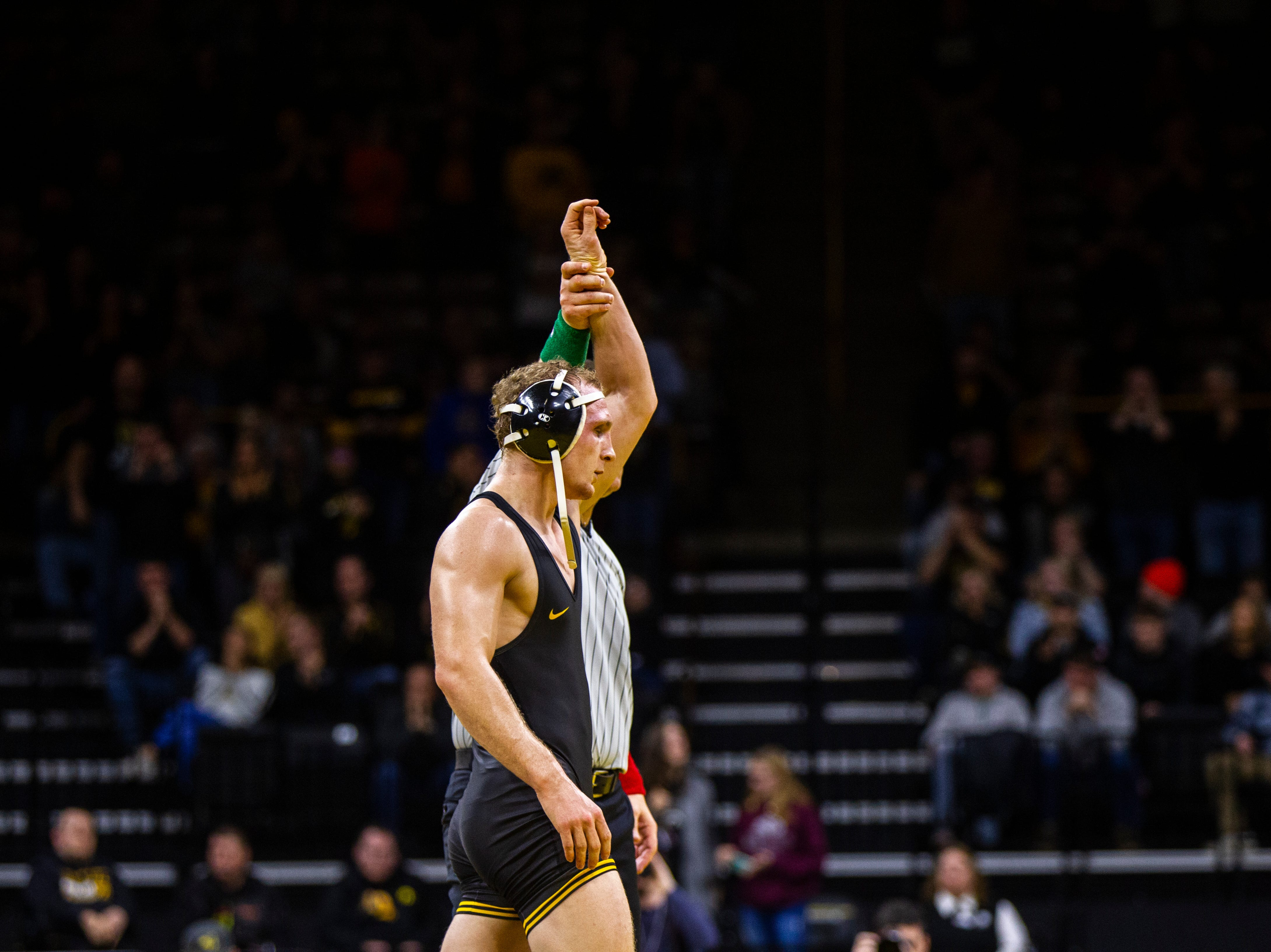 Iowa's Kaleb Young has his hand raised after scoring a decision over Princeton's Quincy Monday at 157 during an NCAA wrestle dual on Friday, Nov. 16, 2018, at Carver-Hawkeye Arena in Iowa City.
