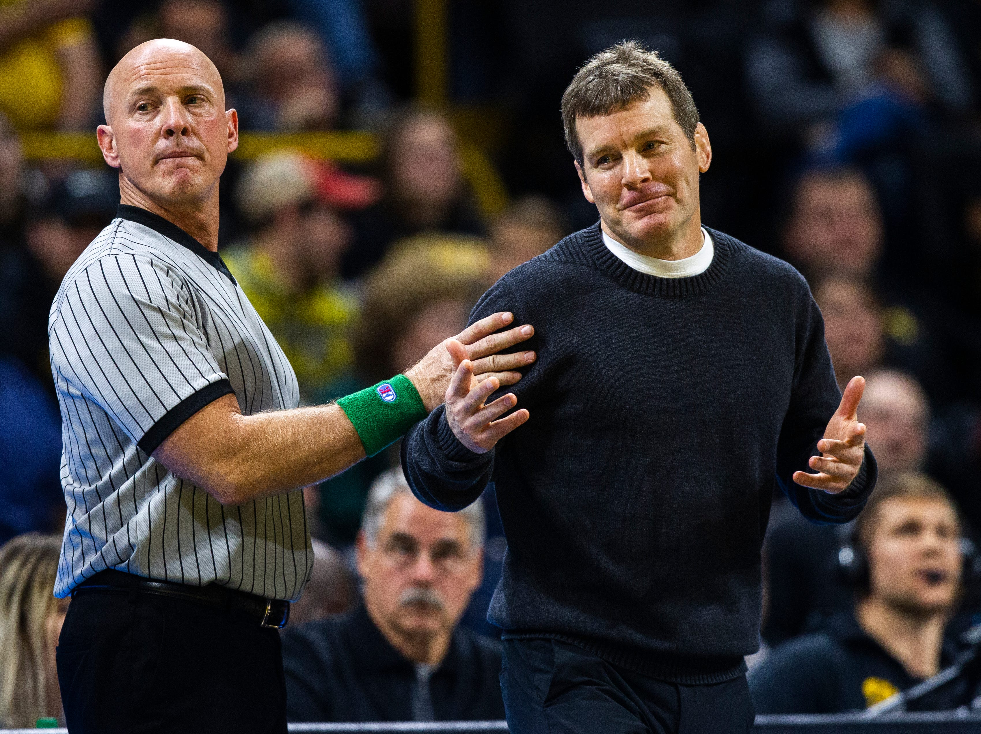 Iowa head coach Tom Brands (right) reacts while talking with officials while calling a challenge during an NCAA wrestling dual on Friday, Nov. 16, 2018, at Carver-Hawkeye Arena in Iowa City.