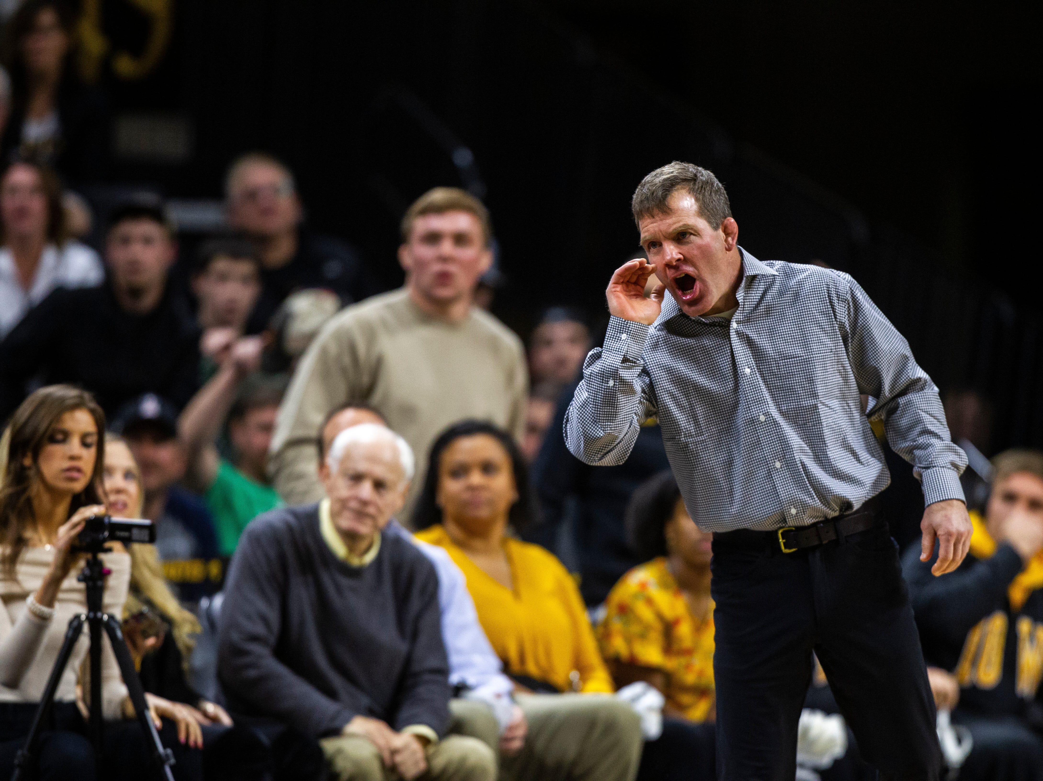Iowa associate head coach Terry Brands calls out during an NCAA wrestle dual on Friday, Nov. 16, 2018, at Carver-Hawkeye Arena in Iowa City.