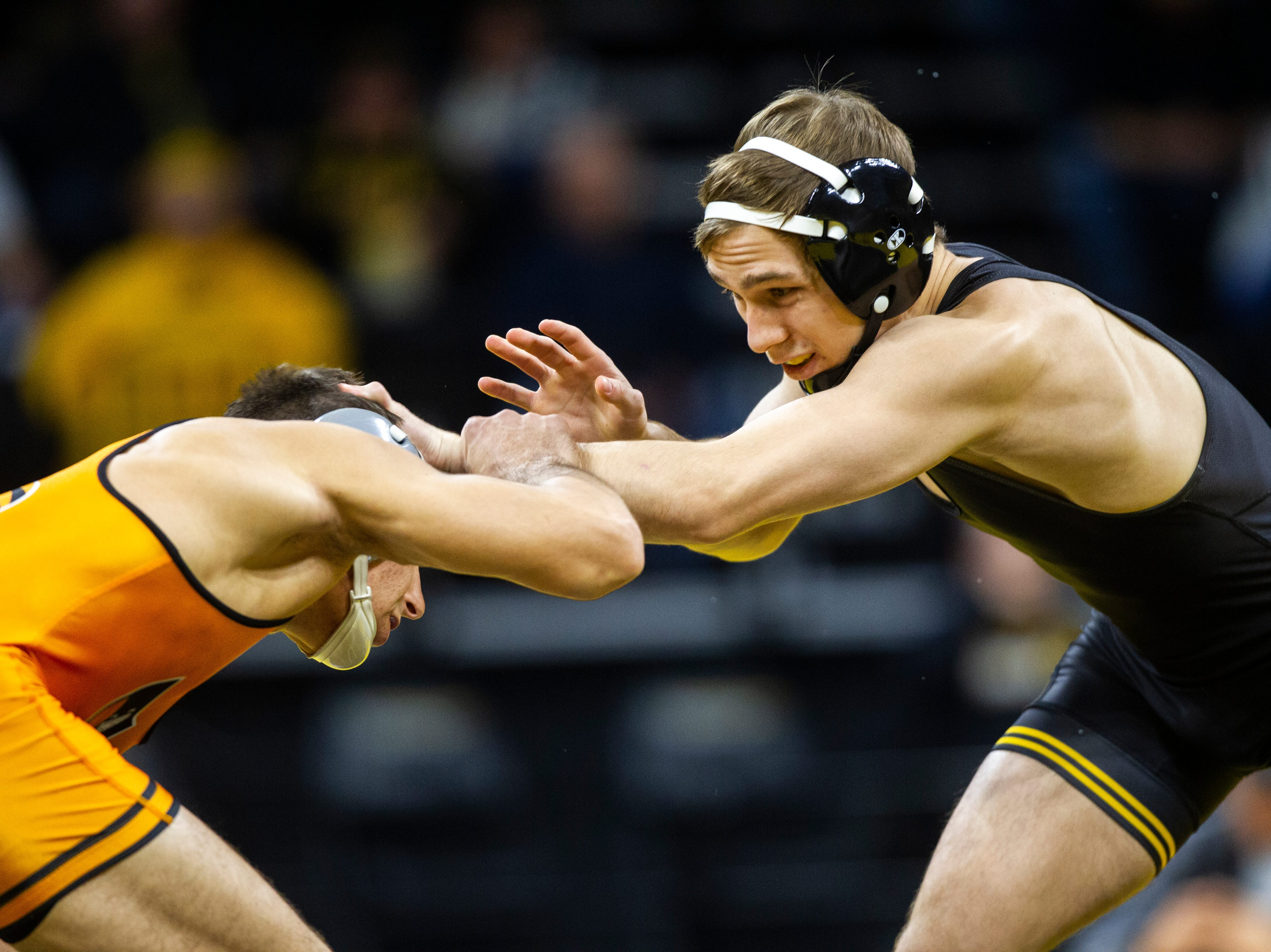 Iowa's Spencer Lee (right) wrestles Princeton's Patrick Glory at 125 during an NCAA wrestle dual on Friday, Nov. 16, 2018, at Carver-Hawkeye Arena in Iowa City.