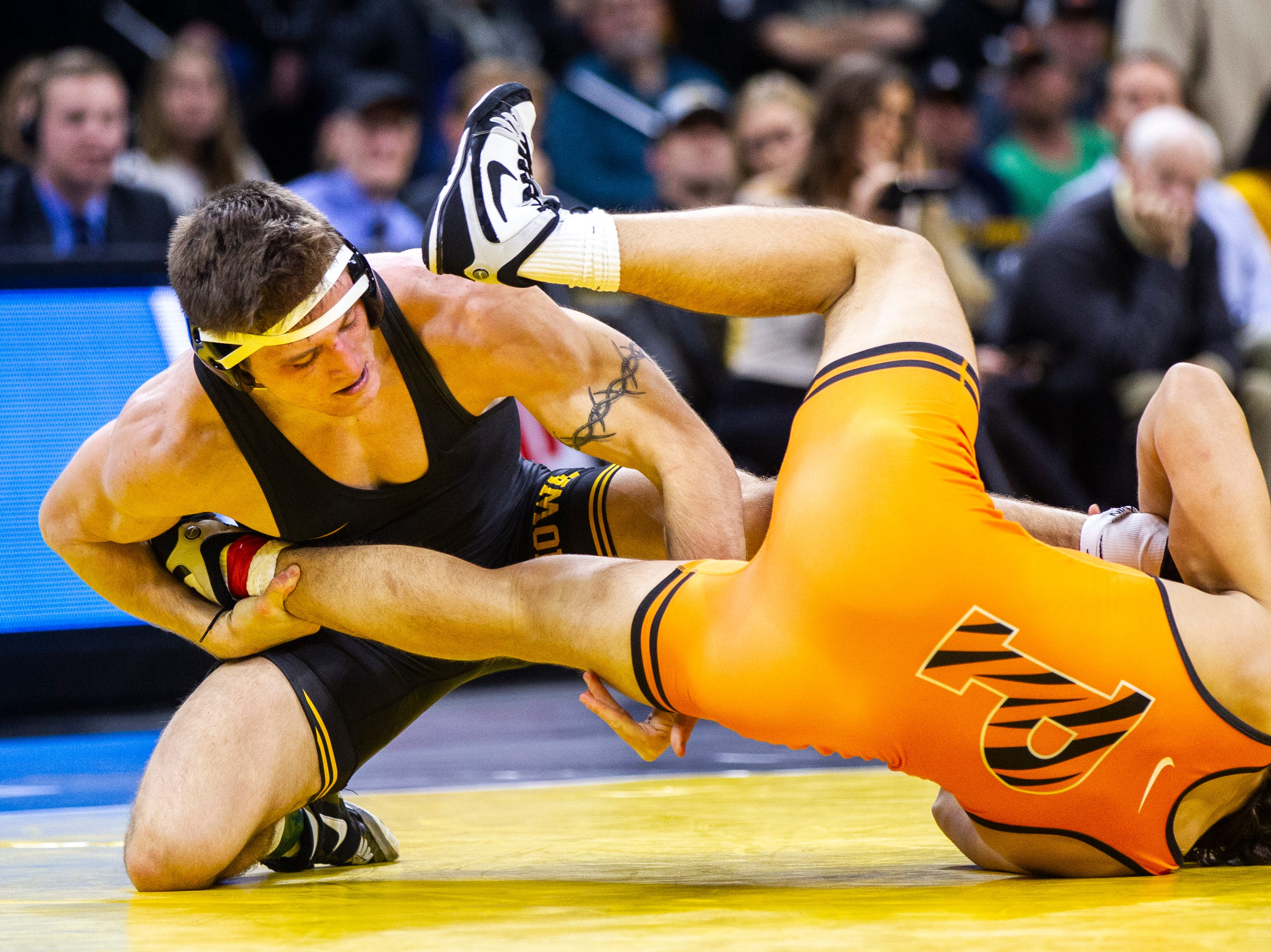 Iowa's Myles Wilson (left) wrestles Princeton's Travis Stefanik at 174 during an NCAA wrestle dual on Friday, Nov. 16, 2018, at Carver-Hawkeye Arena in Iowa City.