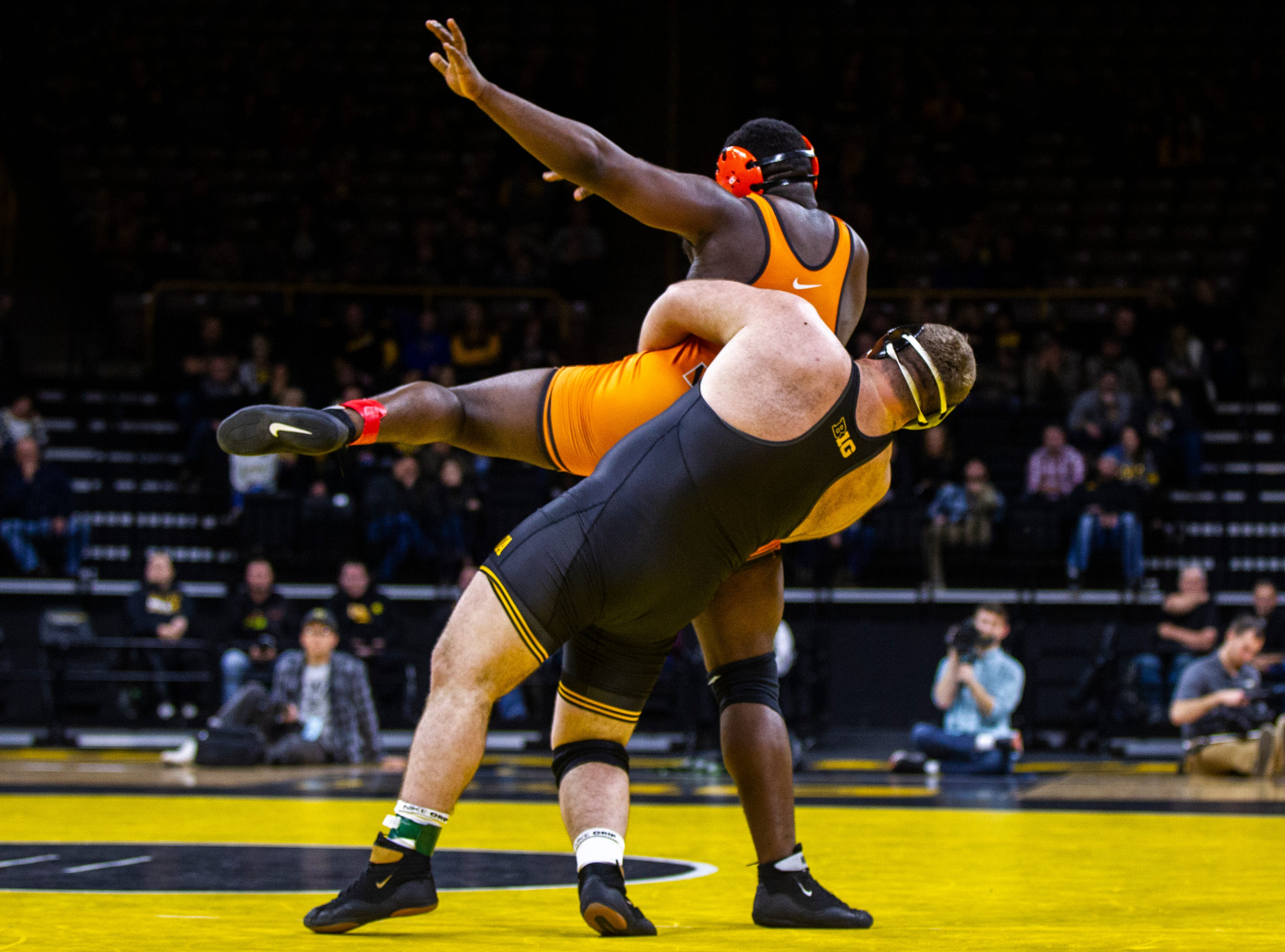 Iowa's Aaron Costello (right) wrestles Princeton's Obinna Ajah at 285 during an NCAA wrestle dual on Friday, Nov. 16, 2018, at Carver-Hawkeye Arena in Iowa City.