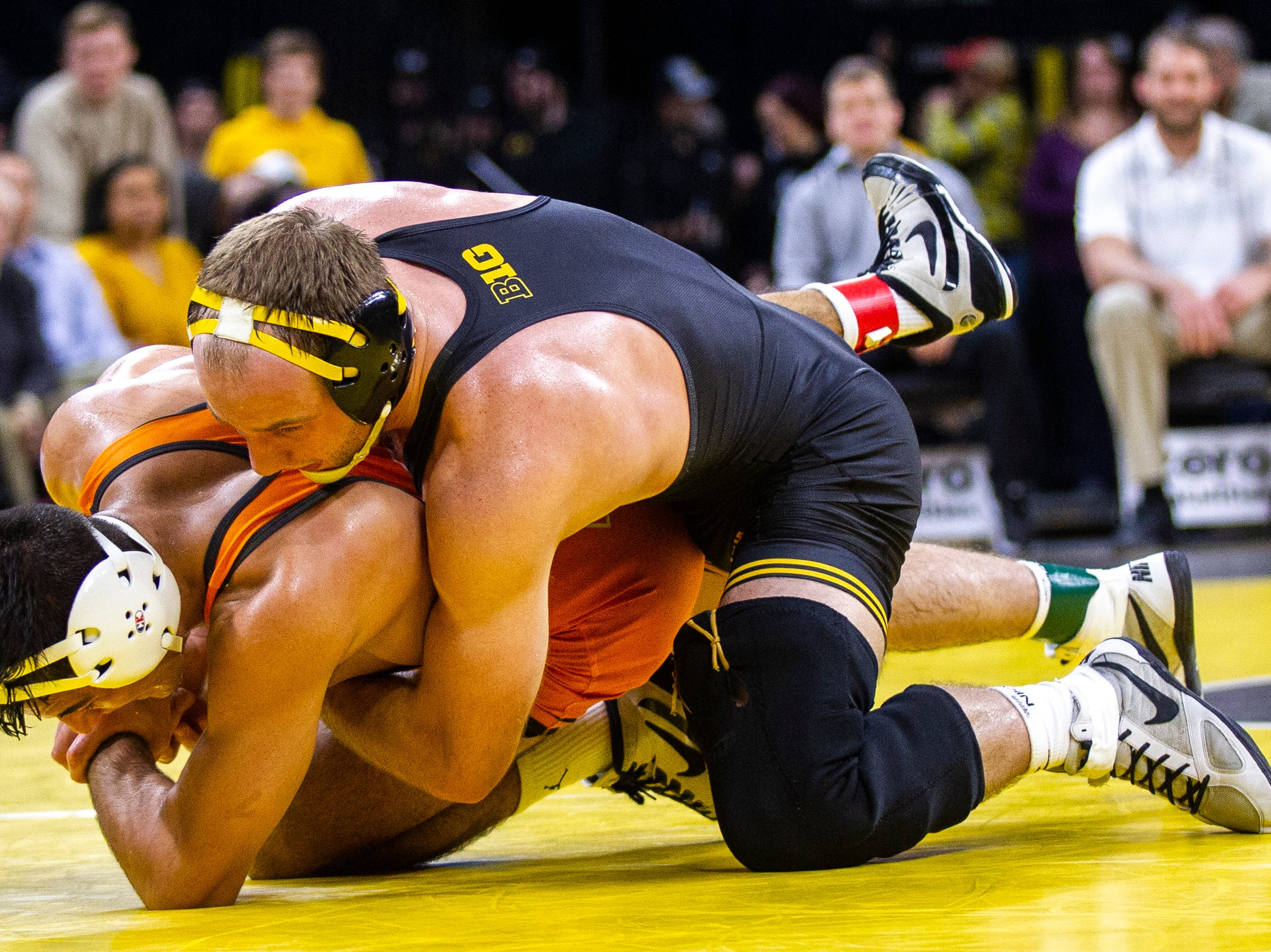 Iowa's Alex Marinelli (right) wrestles Princeton's Dale Tiongson at 165 during an NCAA wrestle dual on Friday, Nov. 16, 2018, at Carver-Hawkeye Arena in Iowa City.