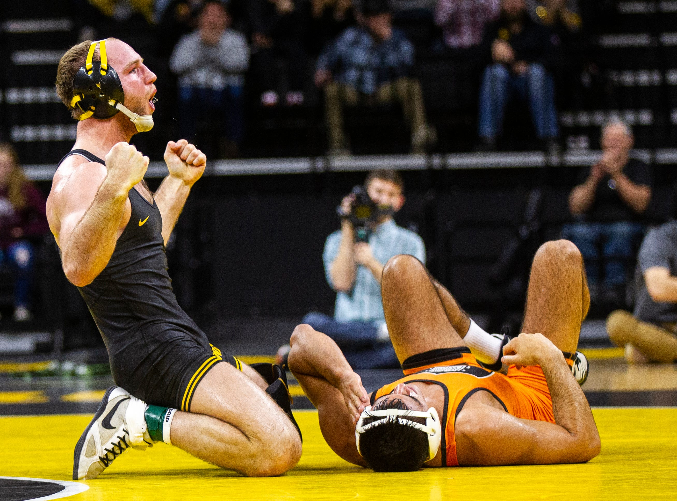 Iowa's Alex Marinelli celebrates after pinning Princeton's Dale Tiongson at 165 during an NCAA wrestle dual on Friday, Nov. 16, 2018, at Carver-Hawkeye Arena in Iowa City.