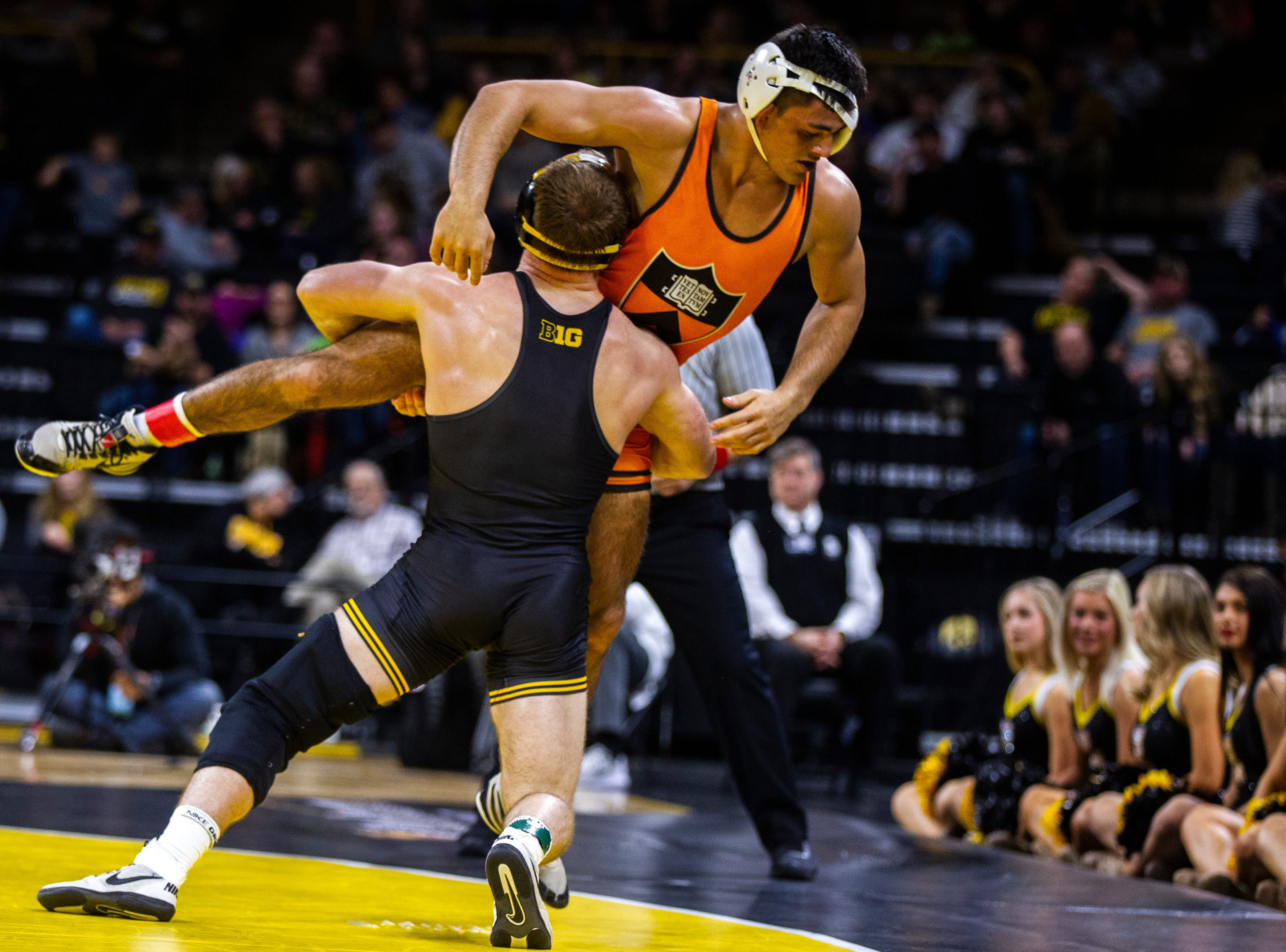 Iowa's Alex Marinelli (left) wrestles Princeton's Dale Tiongson at 165 during an NCAA wrestle dual on Friday, Nov. 16, 2018, at Carver-Hawkeye Arena in Iowa City.