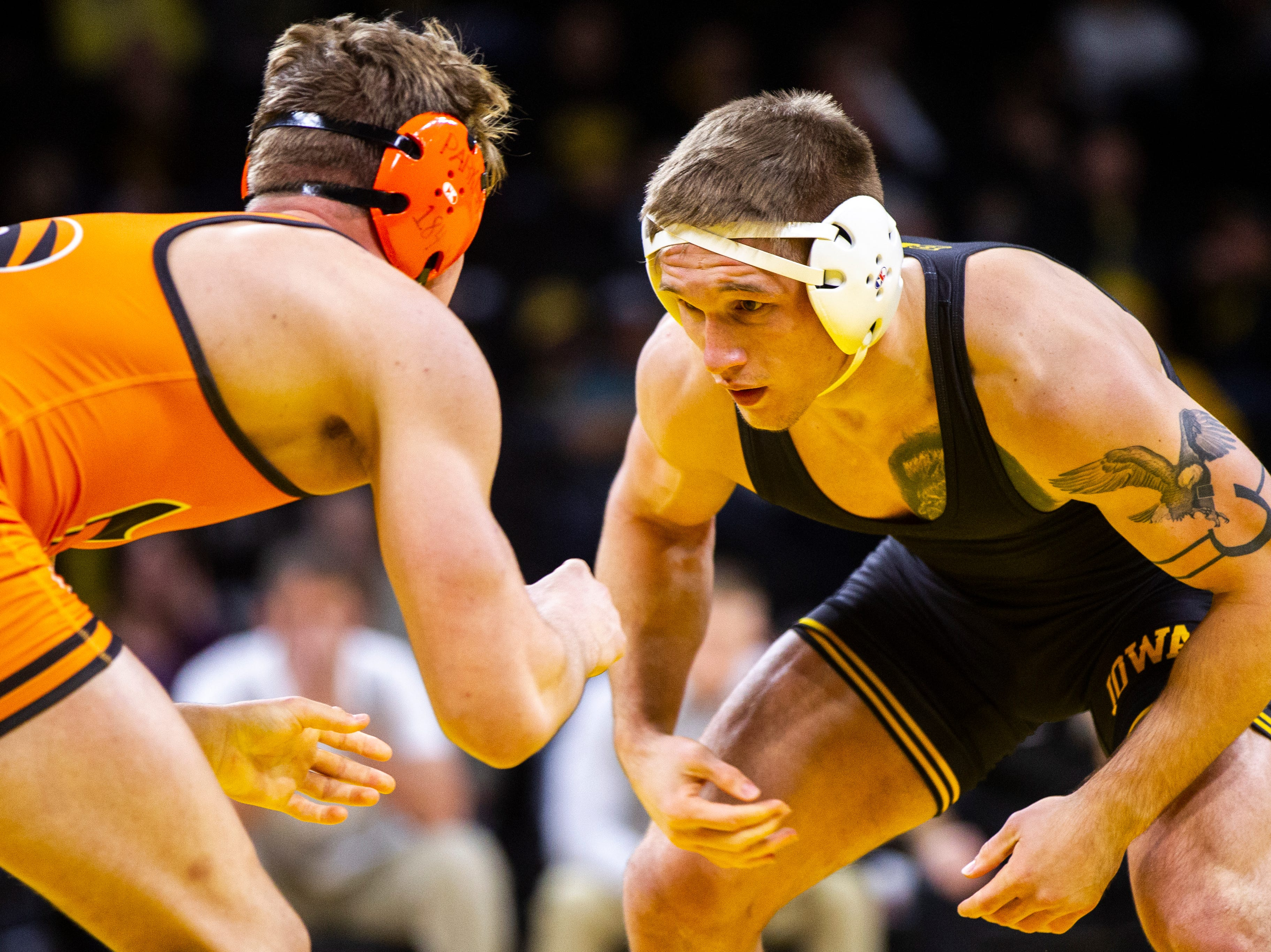 Iowa's Cash Wilcke (right) wrestles Princeton's Kevin Parker at 184 during an NCAA wrestle dual on Friday, Nov. 16, 2018, at Carver-Hawkeye Arena in Iowa City.