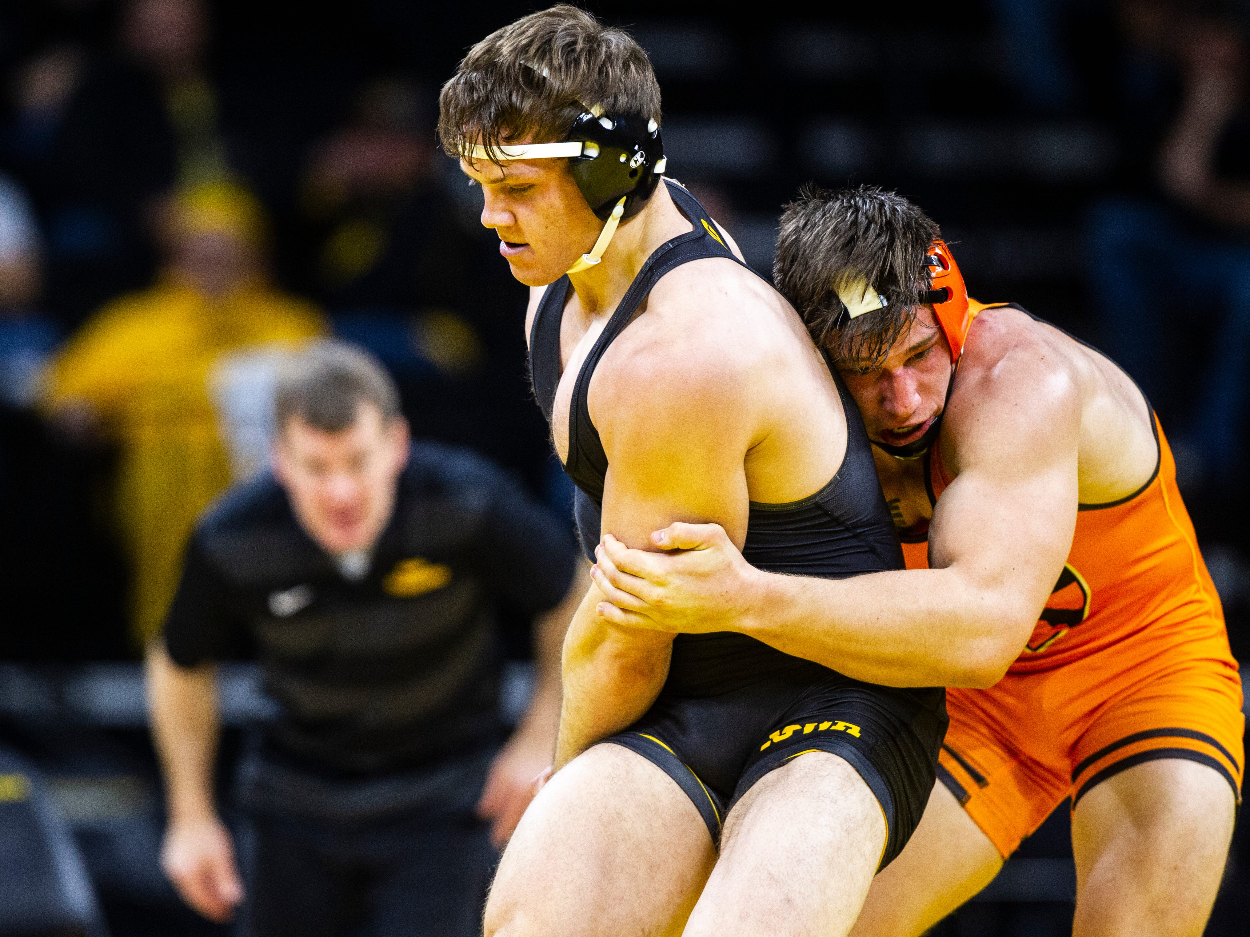 Iowa's Connor Corbin (left) wrestles Princeton's Patrick Brucki at 197 during an NCAA wrestle dual on Friday, Nov. 16, 2018, at Carver-Hawkeye Arena in Iowa City.