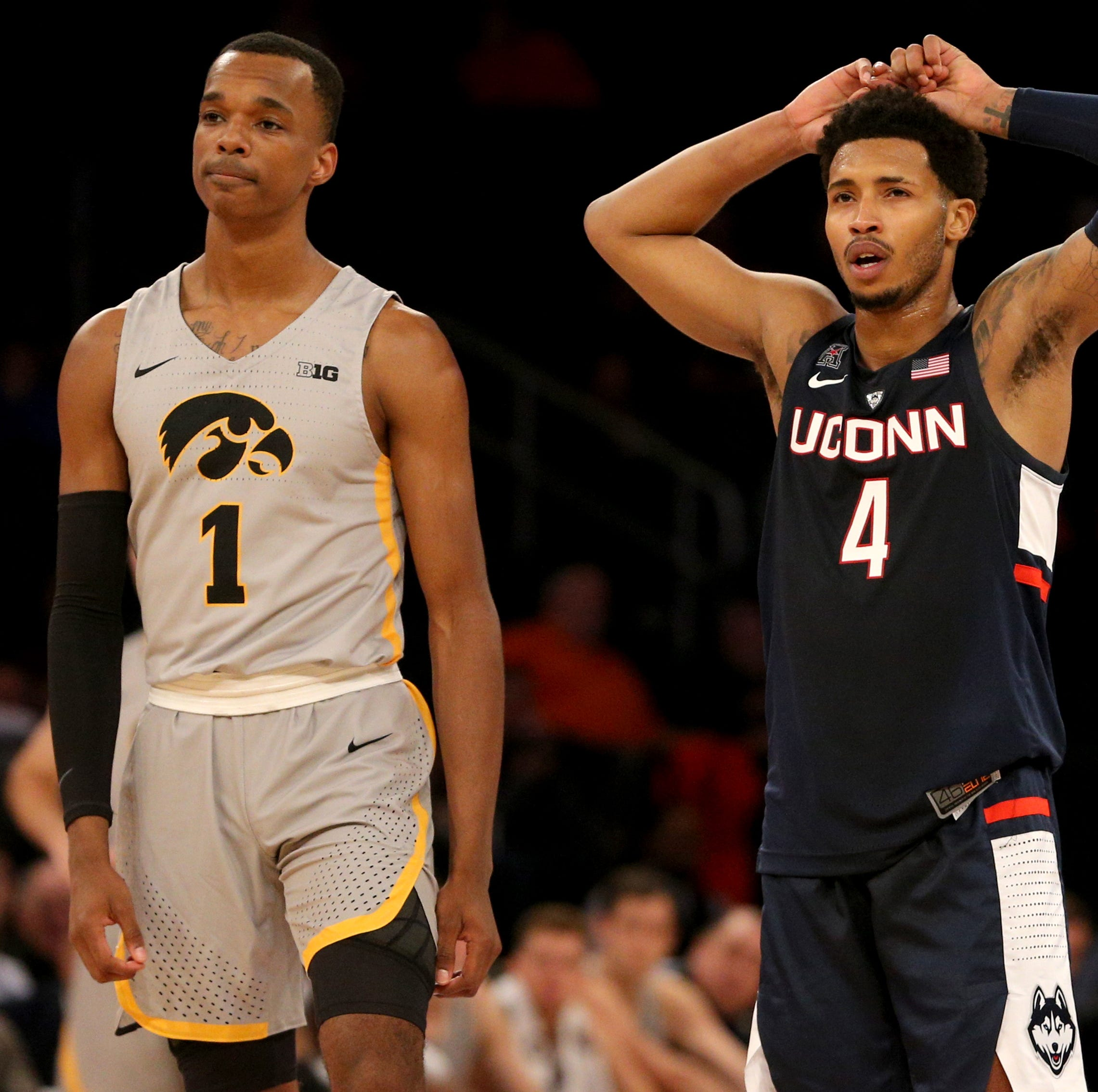 Nov 16, 2018; New York, NY, USA; Connecticut Huskies guard Jalen Adams (4) reacts next to Iowa Hawkeyes guard Maishe Dailey (1) during the first half at Madison Square Garden. Mandatory Credit: Brad Penner-USA TODAY Sports