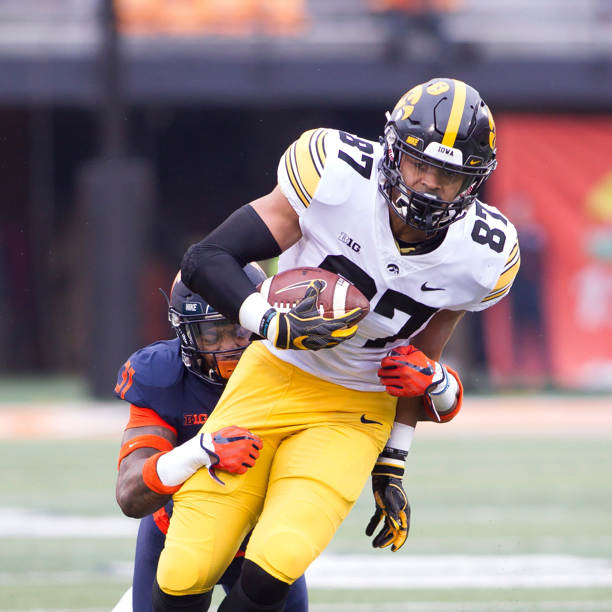 Nov 17, 2018; Champaign, IL, USA; Illinois Fighting Illini defensive back Cameron Watkins (31) tackles Iowa Hawkeyes tight end Noah Fant (87) during the first quarter at Memorial Stadium.