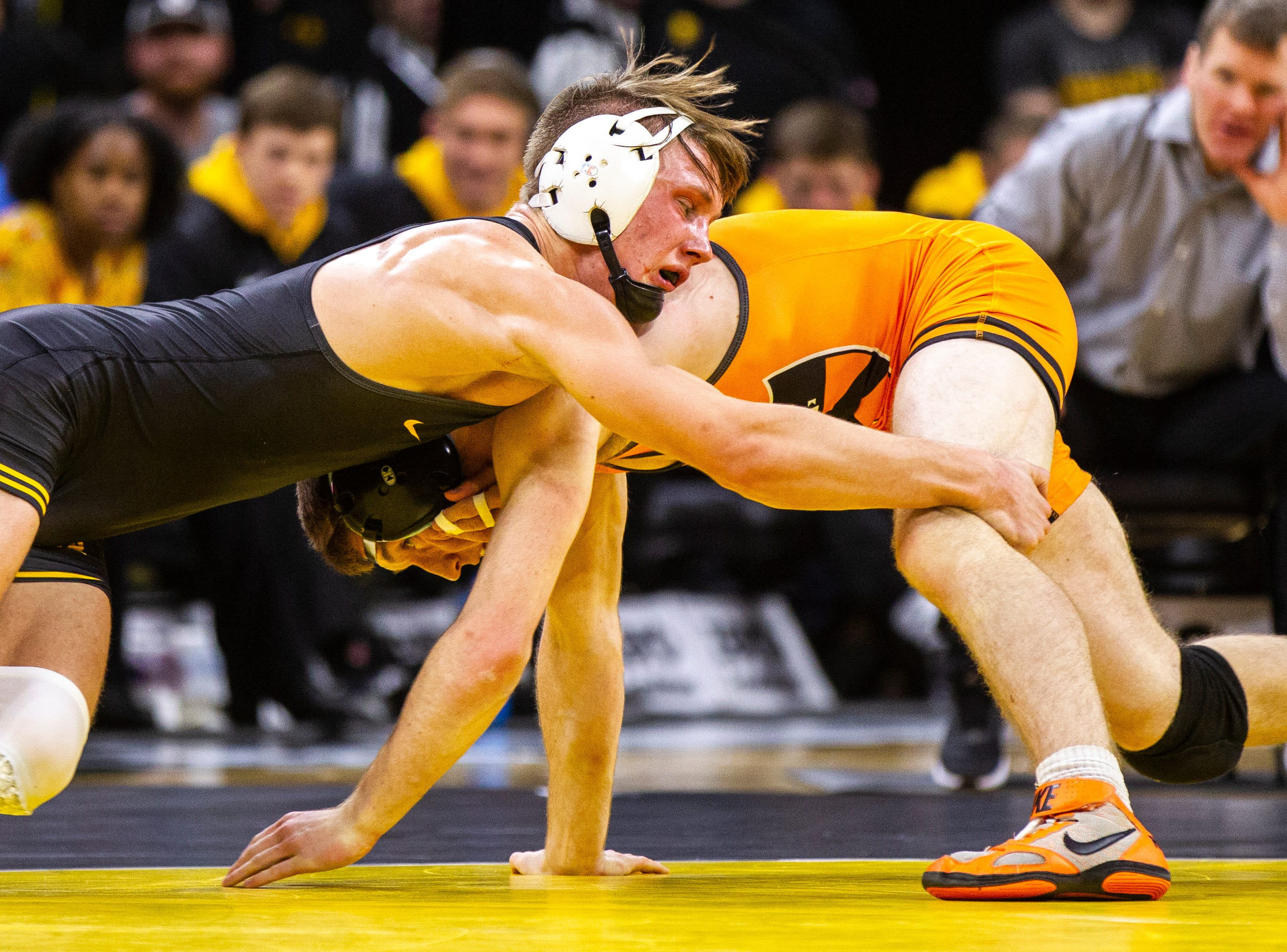 Iowa's Max Murin (left) wrestles Princeton's Marshall Keller at 141 during an NCAA wrestle dual on Friday, Nov. 16, 2018, at Carver-Hawkeye Arena in Iowa City.