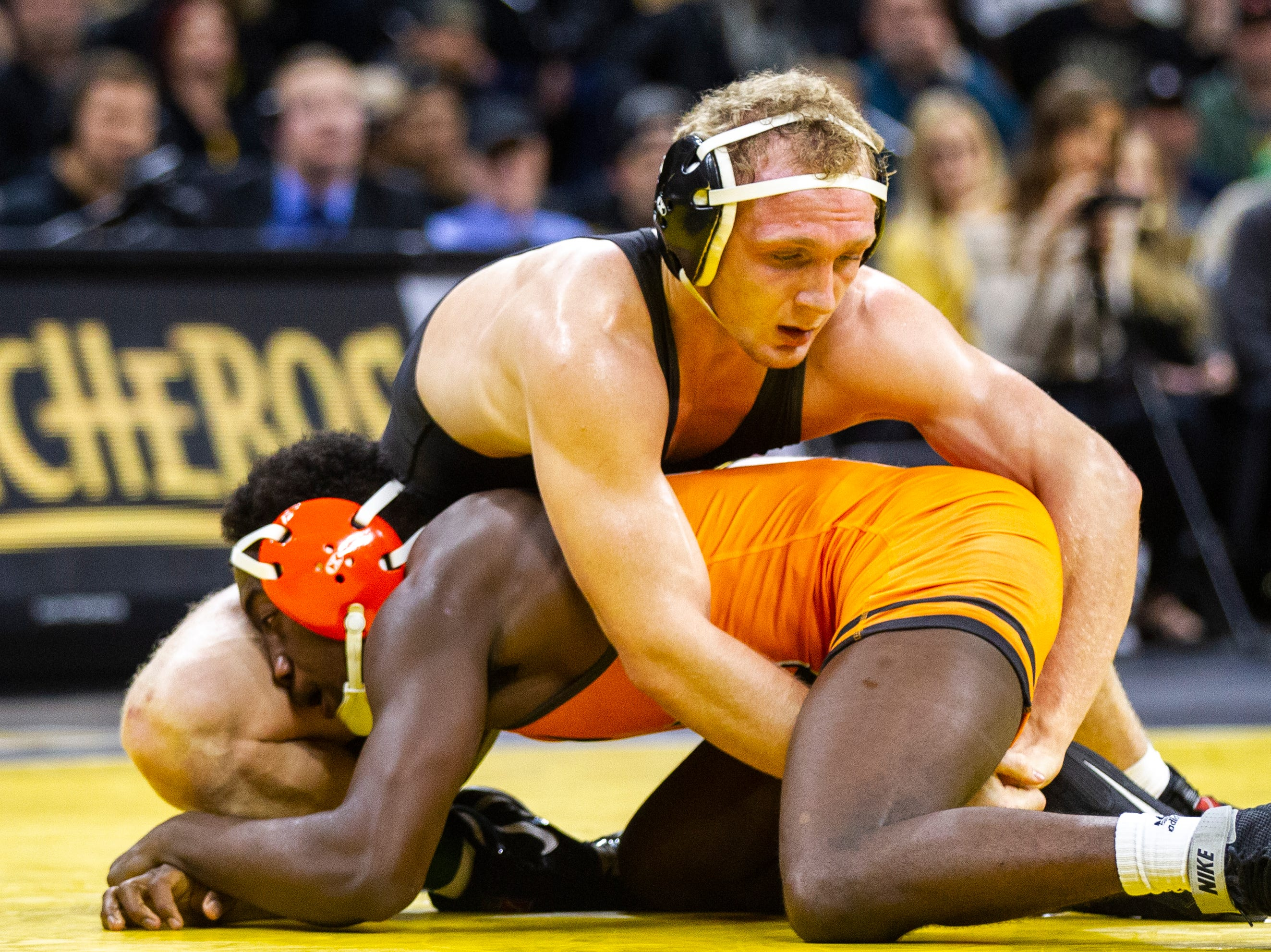 Iowa's Kaleb Young (top) wrestles Princeton's Quincy Monday at 157 during an NCAA wrestle dual on Friday, Nov. 16, 2018, at Carver-Hawkeye Arena in Iowa City.